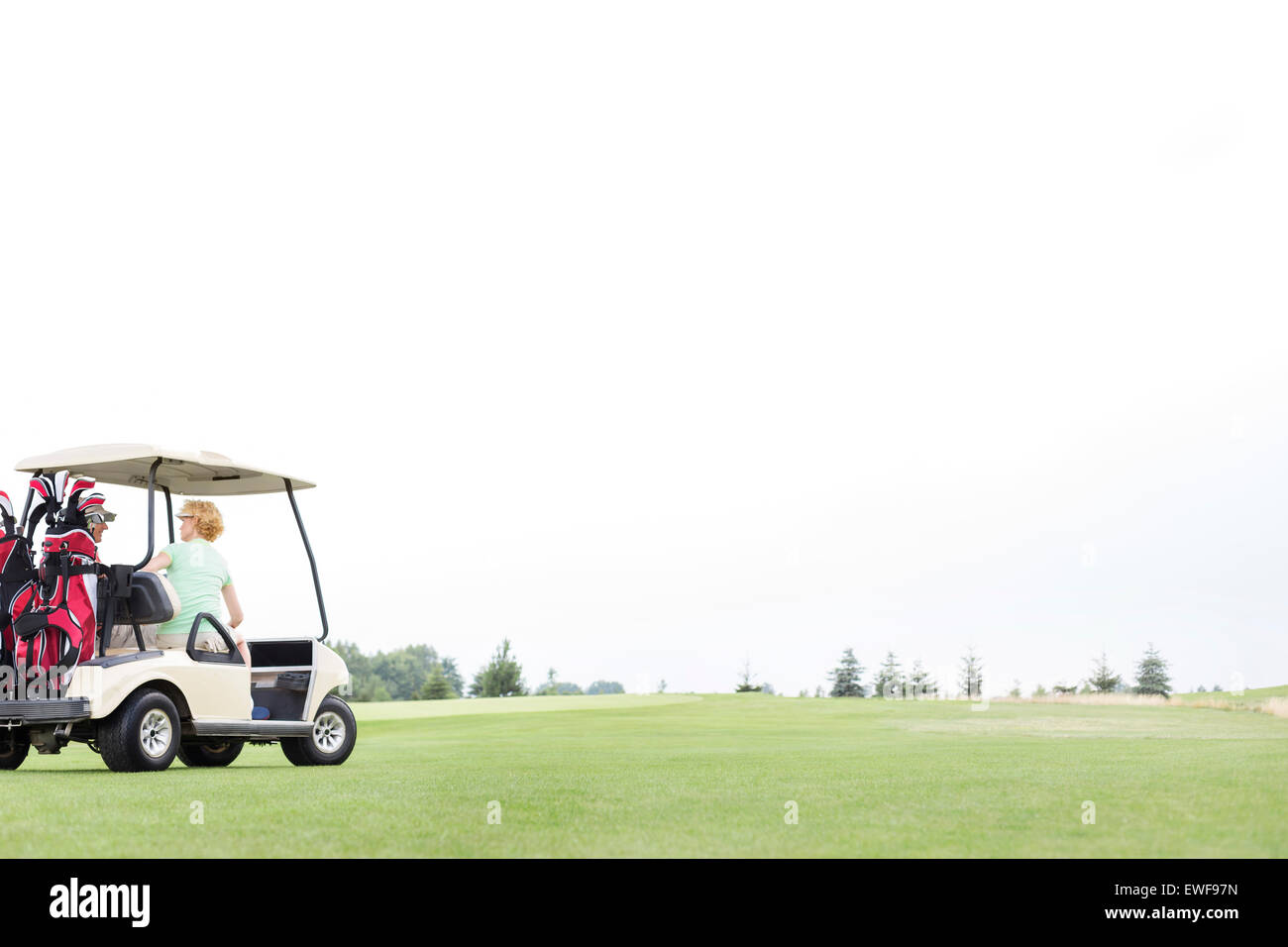 Couple sitting in golf cart against clear sky Stock Photo: 84544425 on sky candles, sky sunglasses, sky bags, sky wheels, sky games, sky comedy, sky cars, sky lifts,