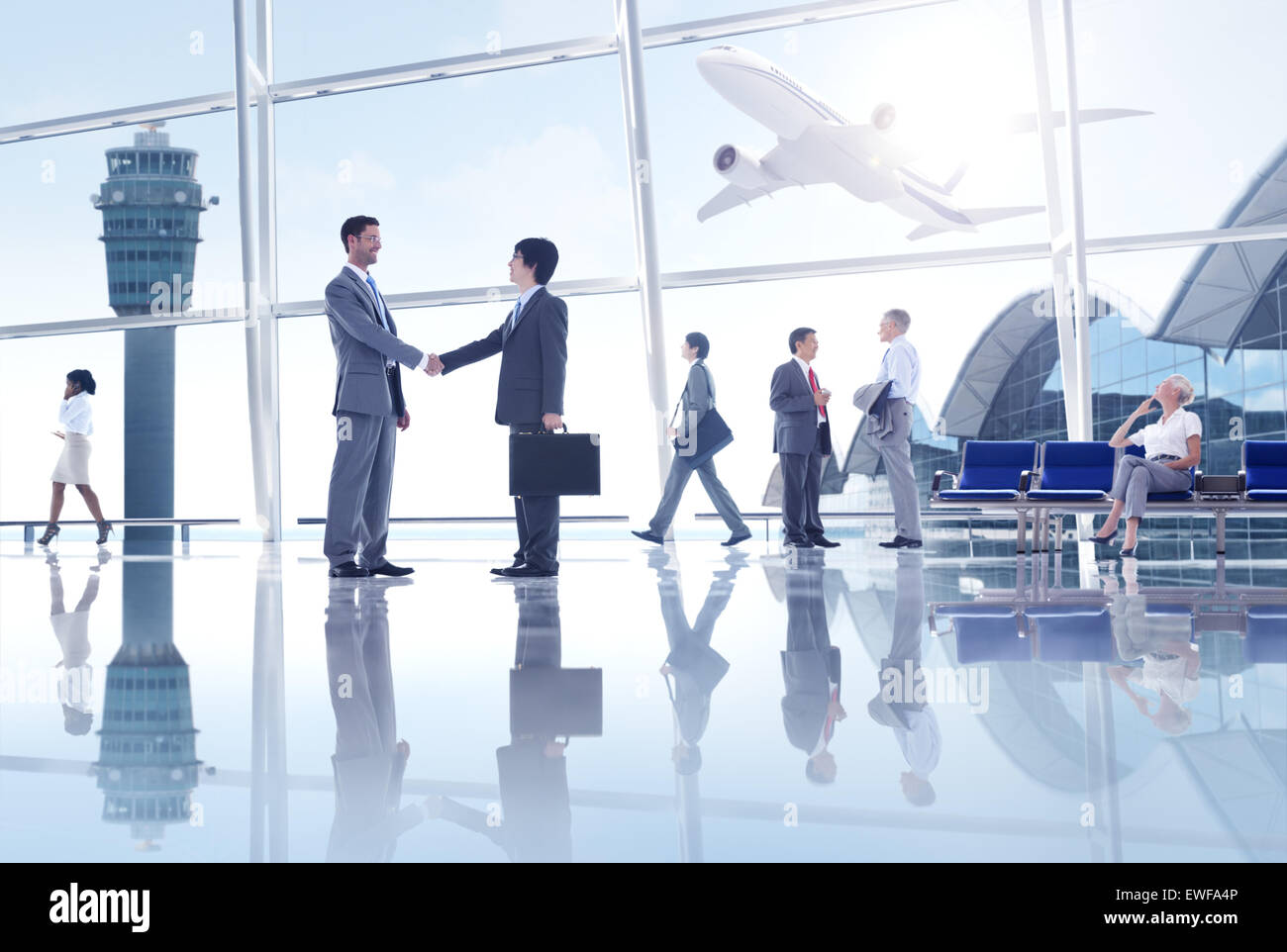 Group of People in the Airport - Stock Image
