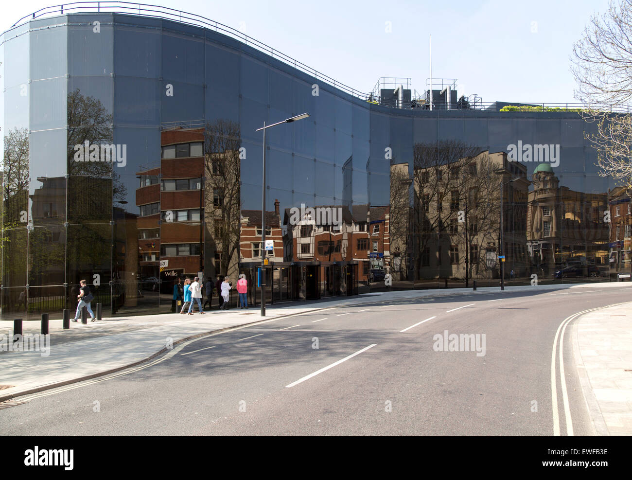 Reflective glass walls of Willis building, Ipswich, Suffolk, England, UK designed by Norman Foster 1970s - Stock Image
