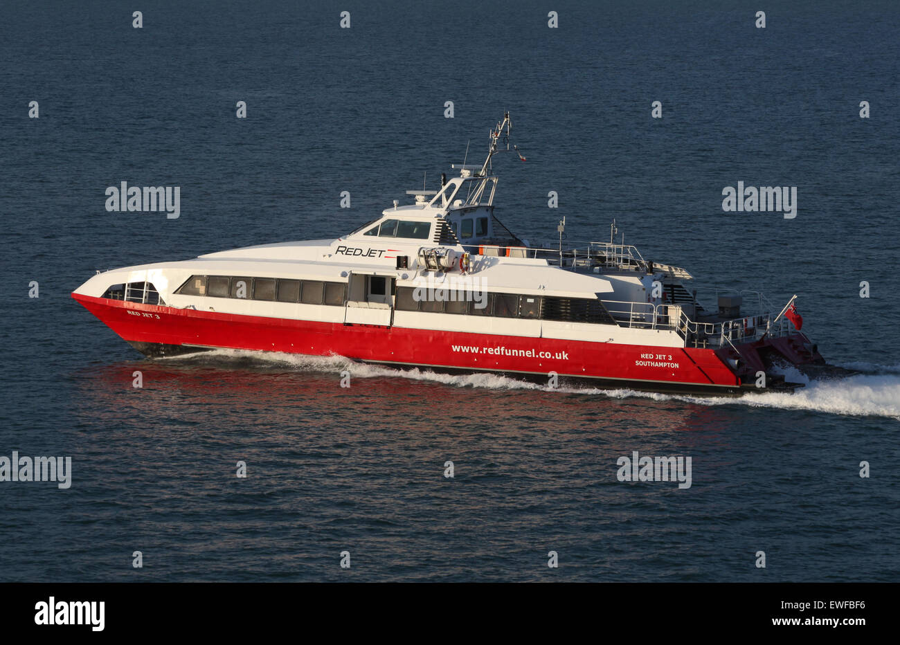 Red Funnel Ferries Red Jet operating between Southampton and Cowes on the Isle of Wight - Stock Image