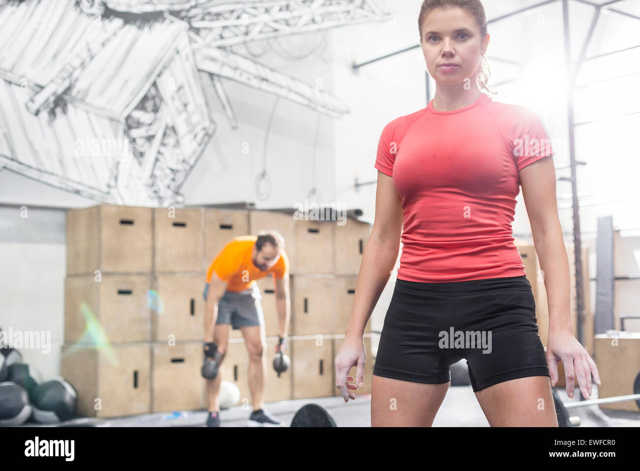 Portrait of confident woman standing in crossfit gym Stock Photo