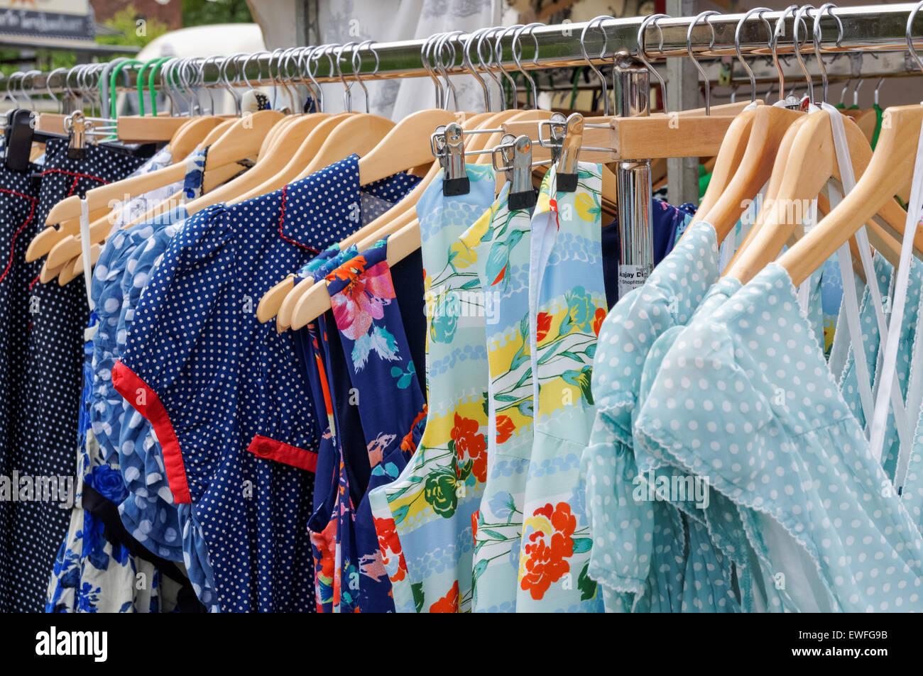 Vintage dresses hanging at the flea market in Greenwich, London England United Kingdom UK - Stock Image