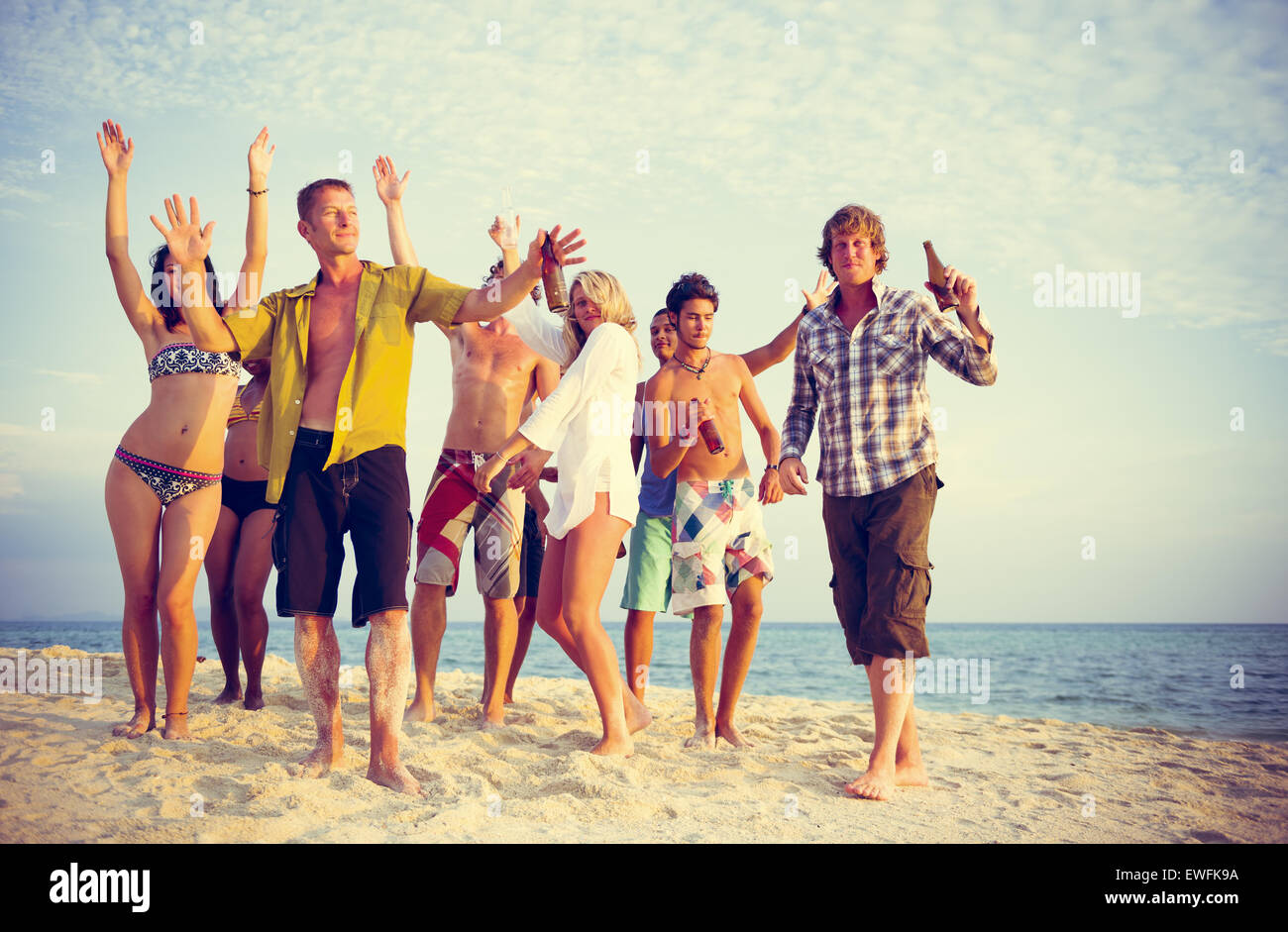 Group of people party on the beach. - Stock Image