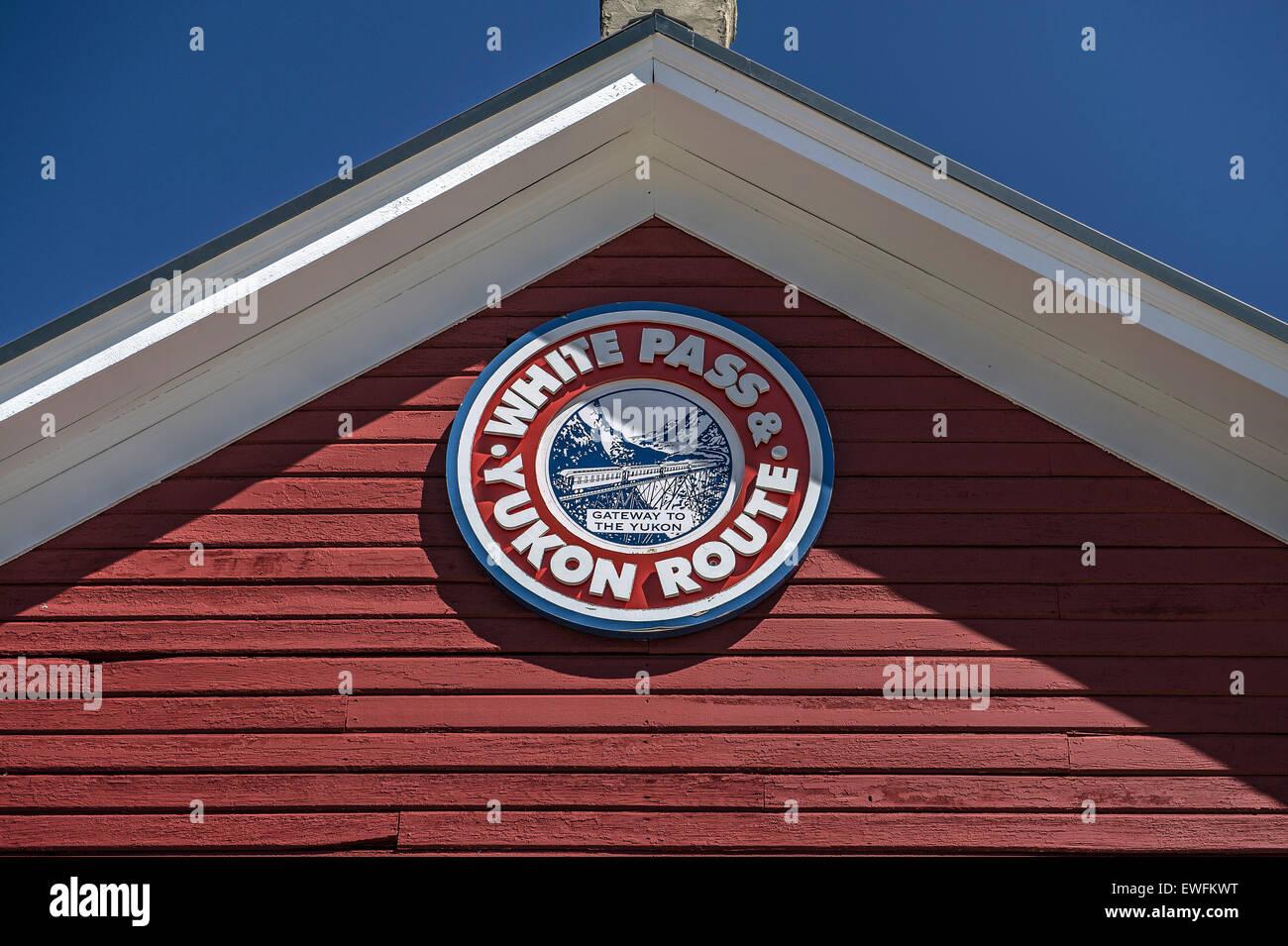 Pediment with logo, Lake Bennett station, British Columbia, Canada - Stock Image