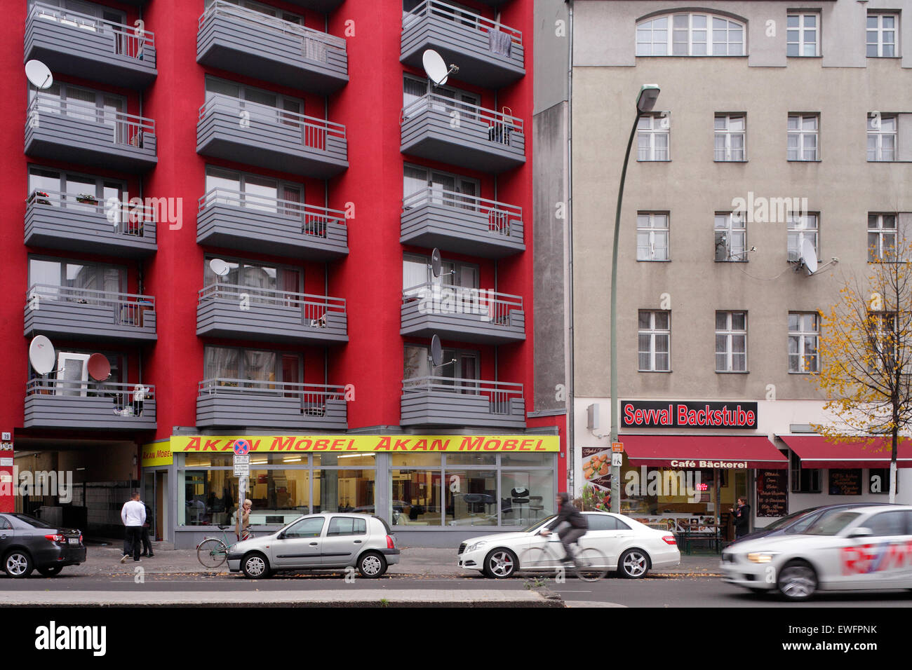 Berlin, Germany, reconstructed residential buildings and old building in the Karl-Marx-Strasse Stock Photo