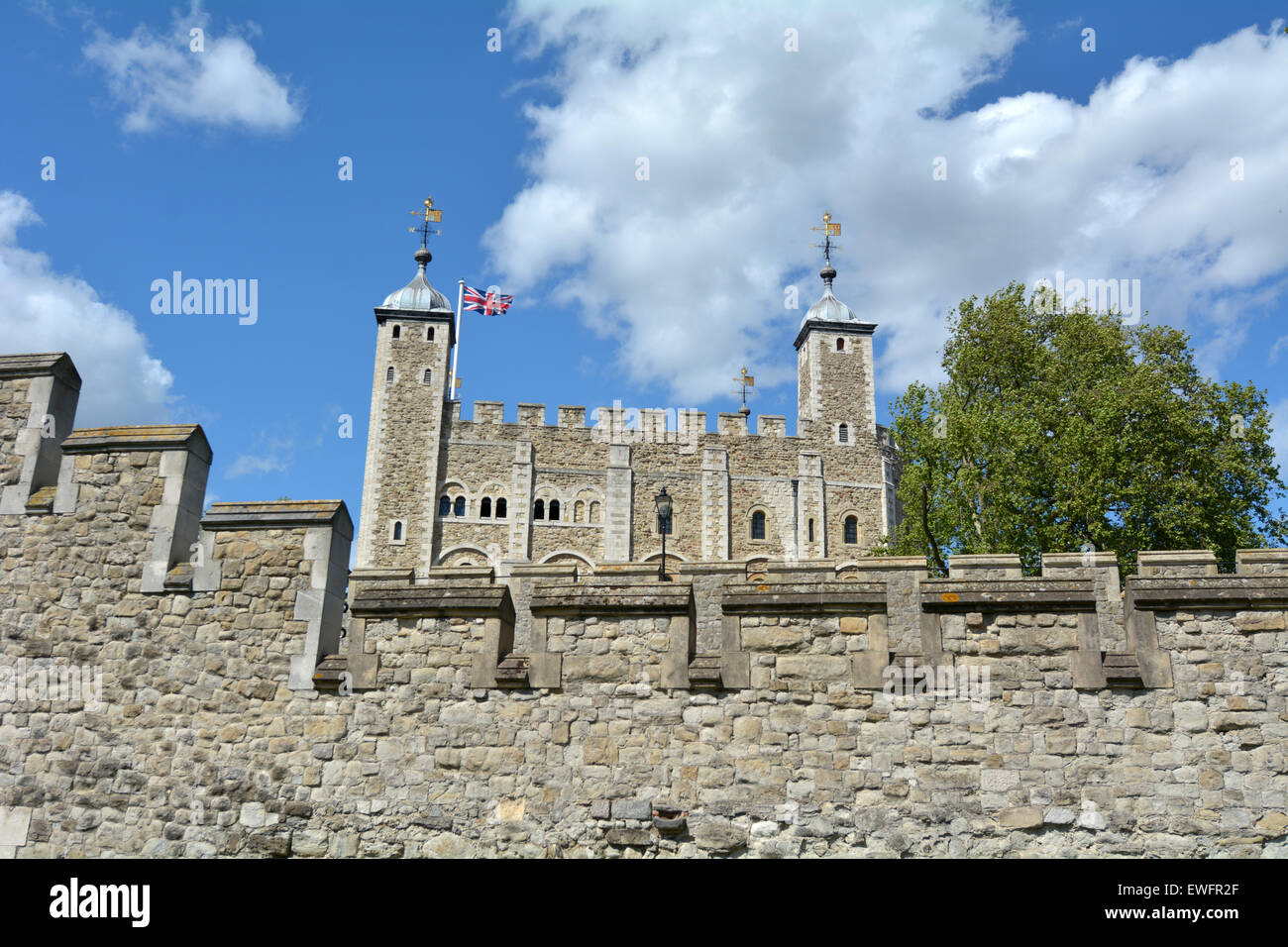The outer curtain wall and the White Tower of The Tower of London in City of London, UK. - Stock Image