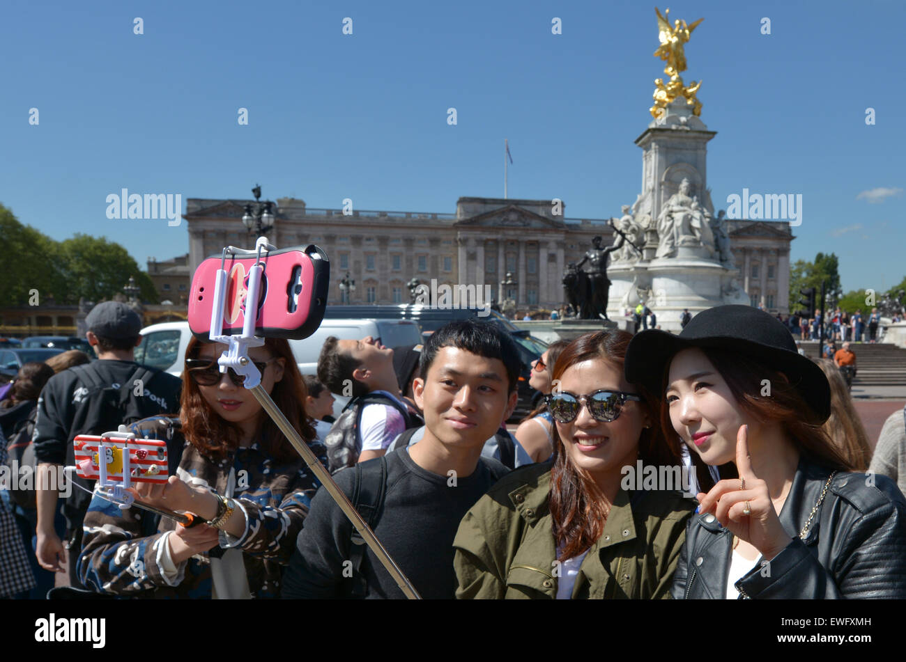 LONDON - MAY 13 2015:Chines tourists taking a selfie in Buckingham Palace. It's one of most popular tourist - Stock Image