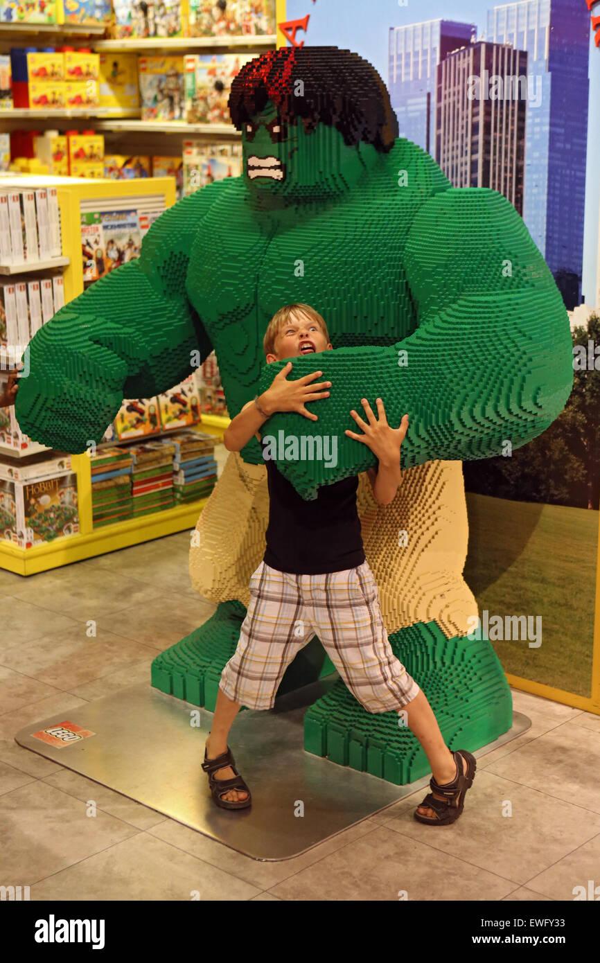 New York, USA, boy playing with the built of Lego bricks cartoon character Hulk Stock Photo