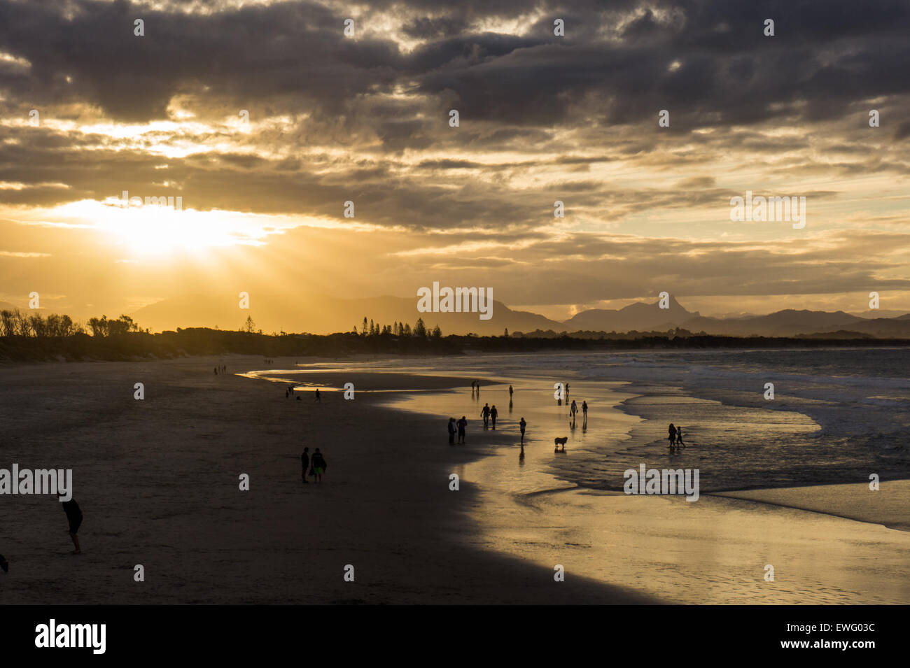 People on Ocean Beach at Sunset - Stock Image