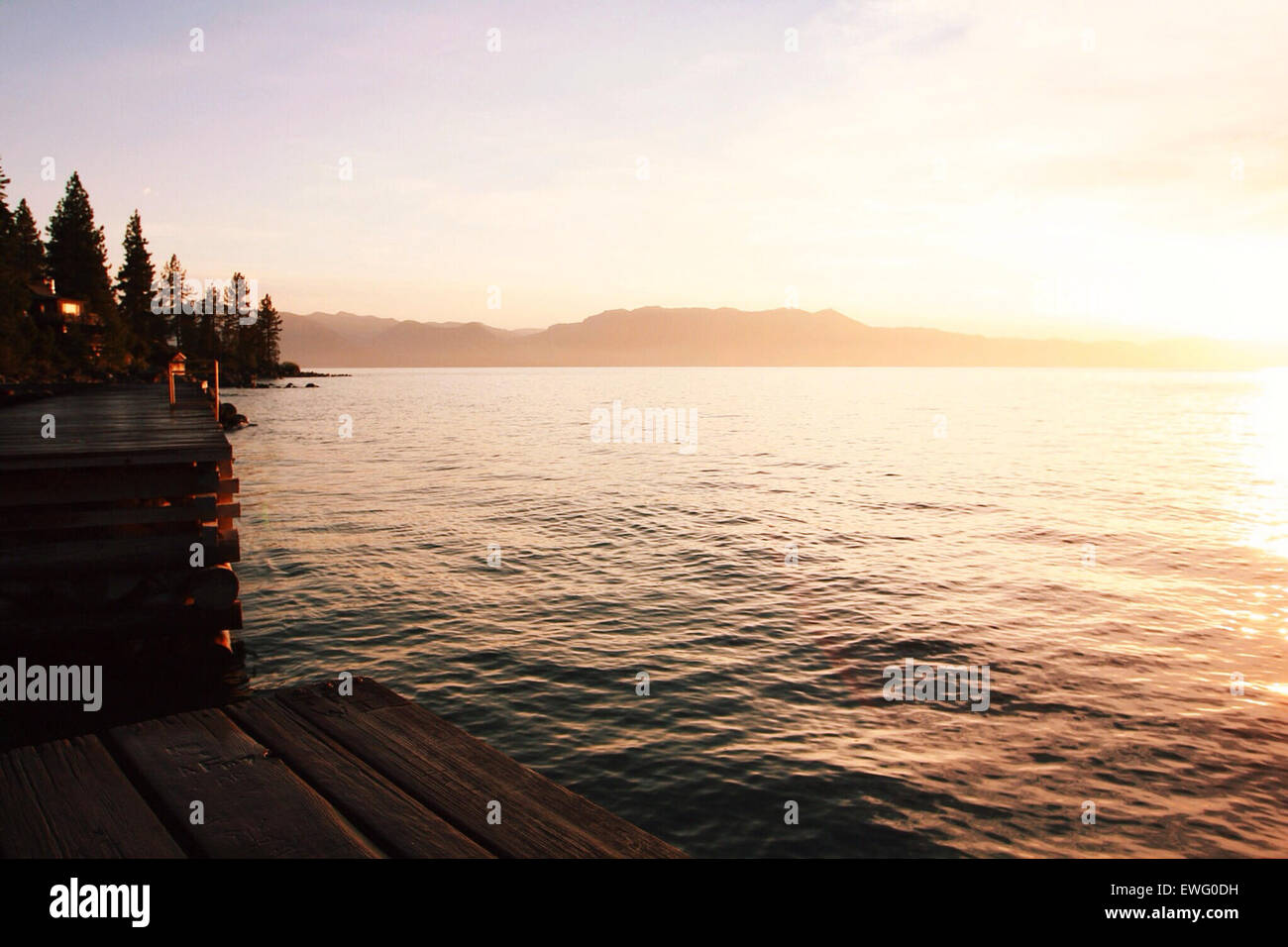 Wooden Deck Overlooking a Lake - Stock Image