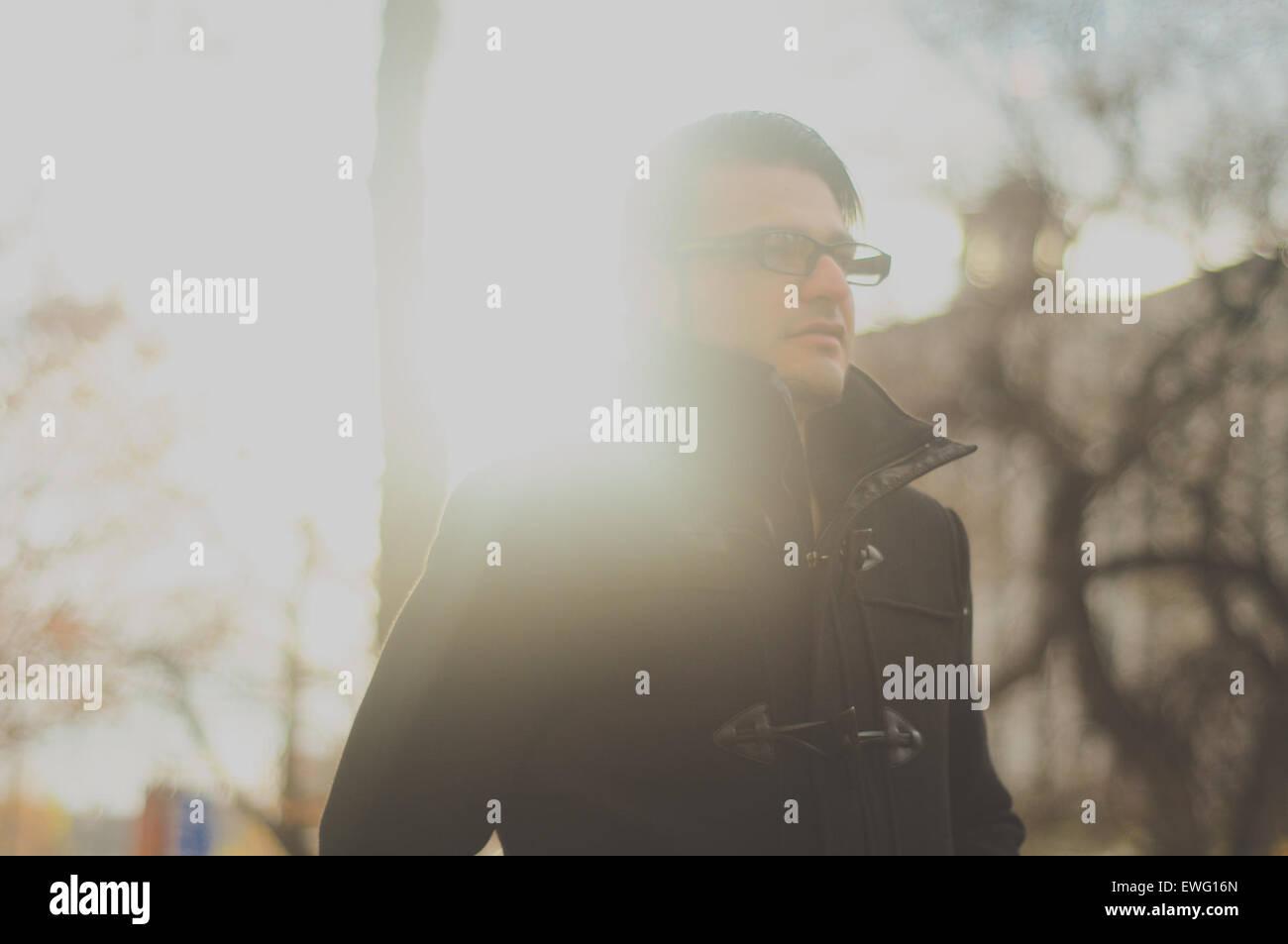 Male in Glasses Wearing Black Jacket Stock Photo