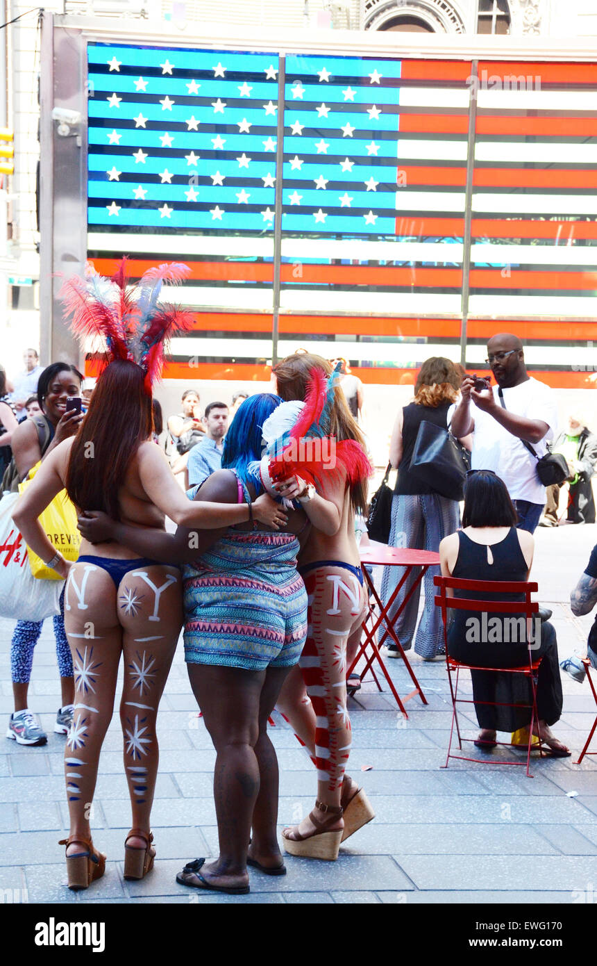 stars and stripes body paint women times square new york usa tourists photo - Stock Image