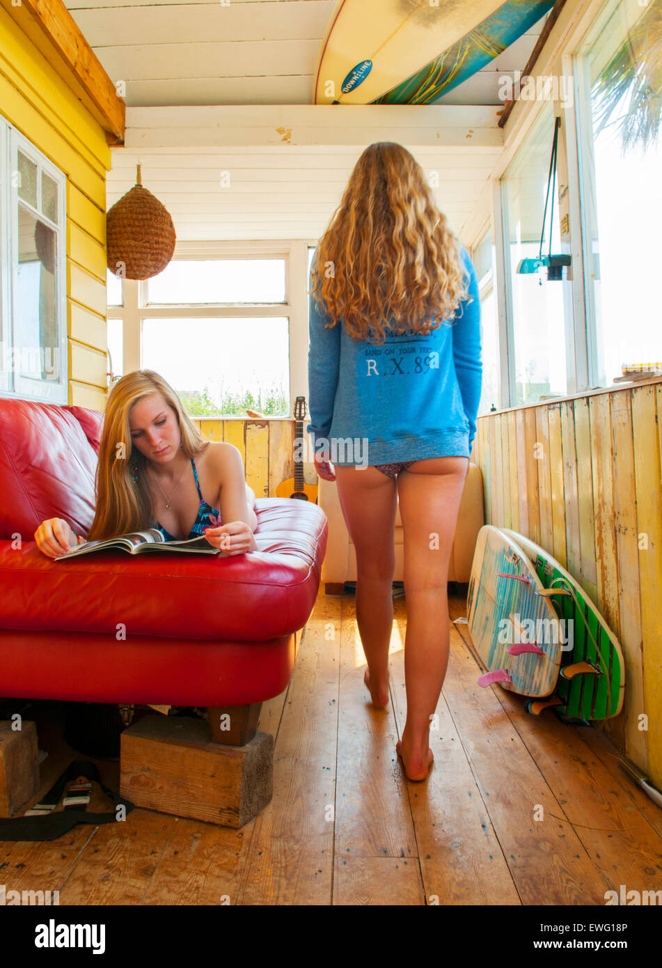Surfer girls hanging out at a beach, on a hot summers day in Cornwall, UK. - Stock Image
