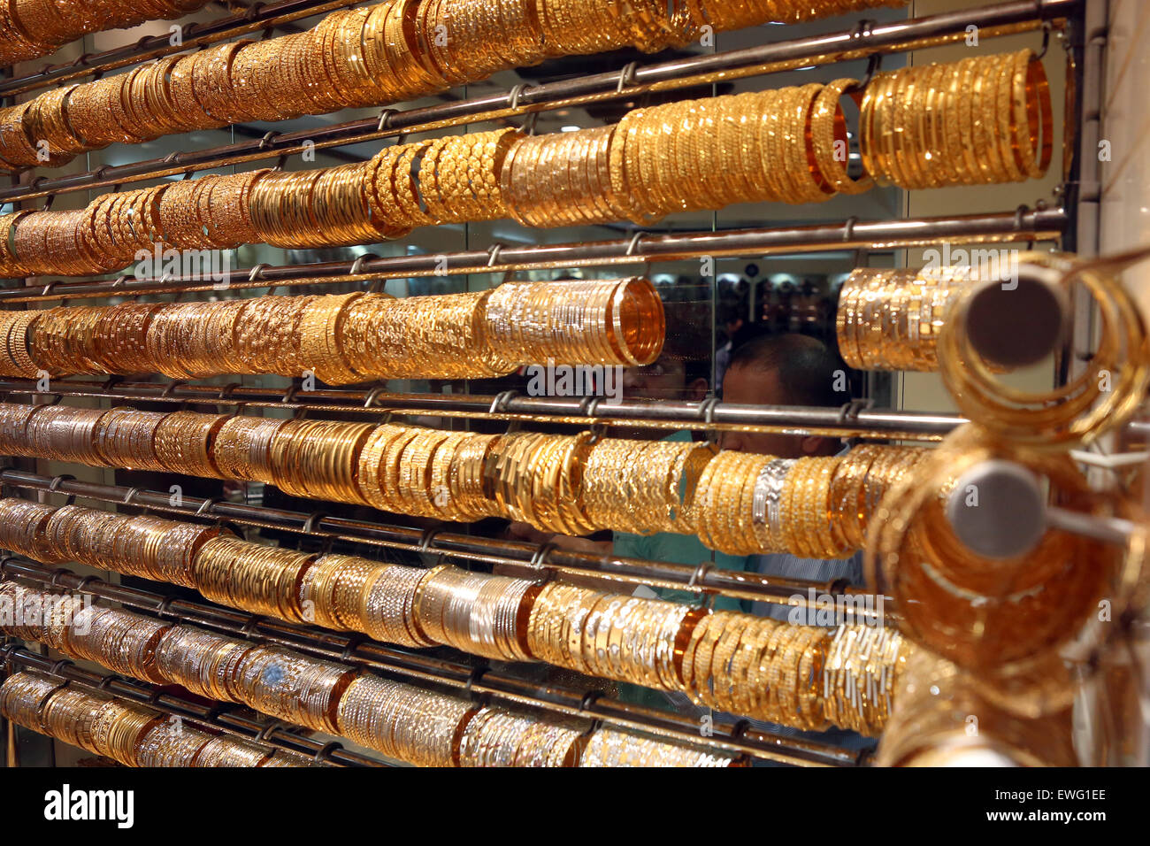 Dubai, United Arab Emirates, golden bracelets in a shop window - Stock Image