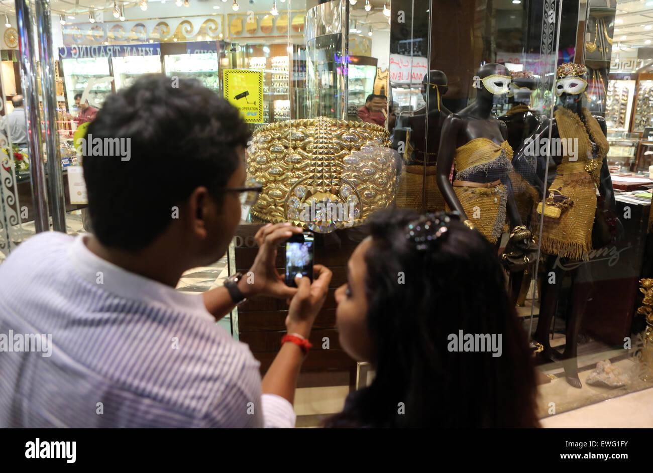 Dubai, United Arab Emirates, man photographs the Star of Taiba Stock