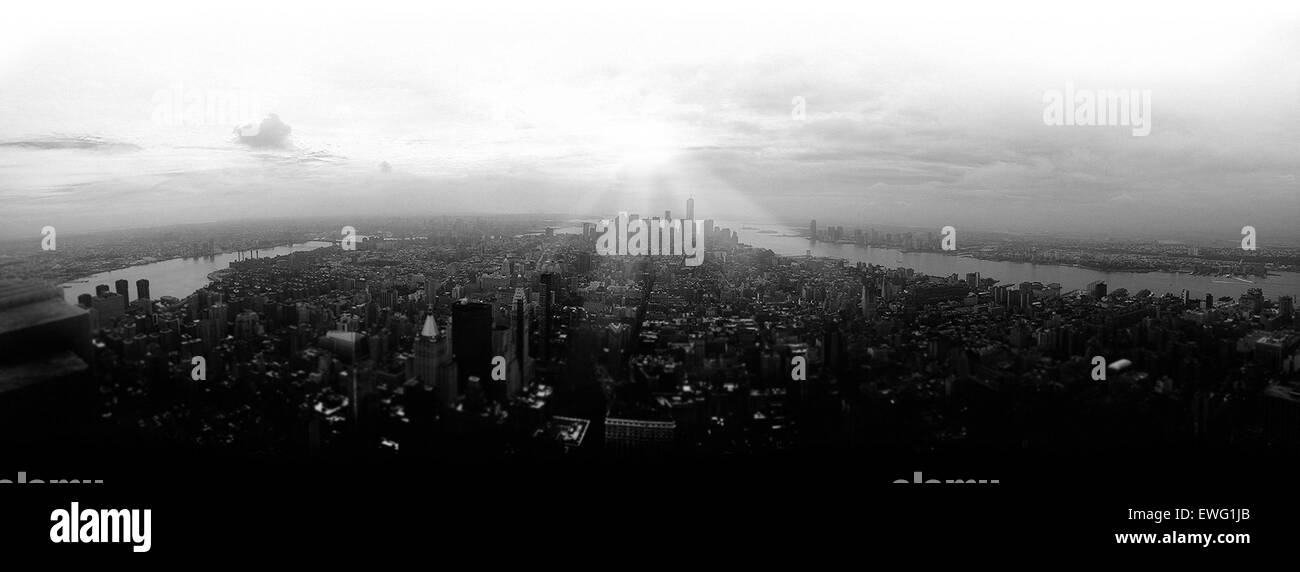 Black and White City by River City Cityscape Clouds River Skyscrapers Sunshine Water black And White outdoor sky - Stock Image