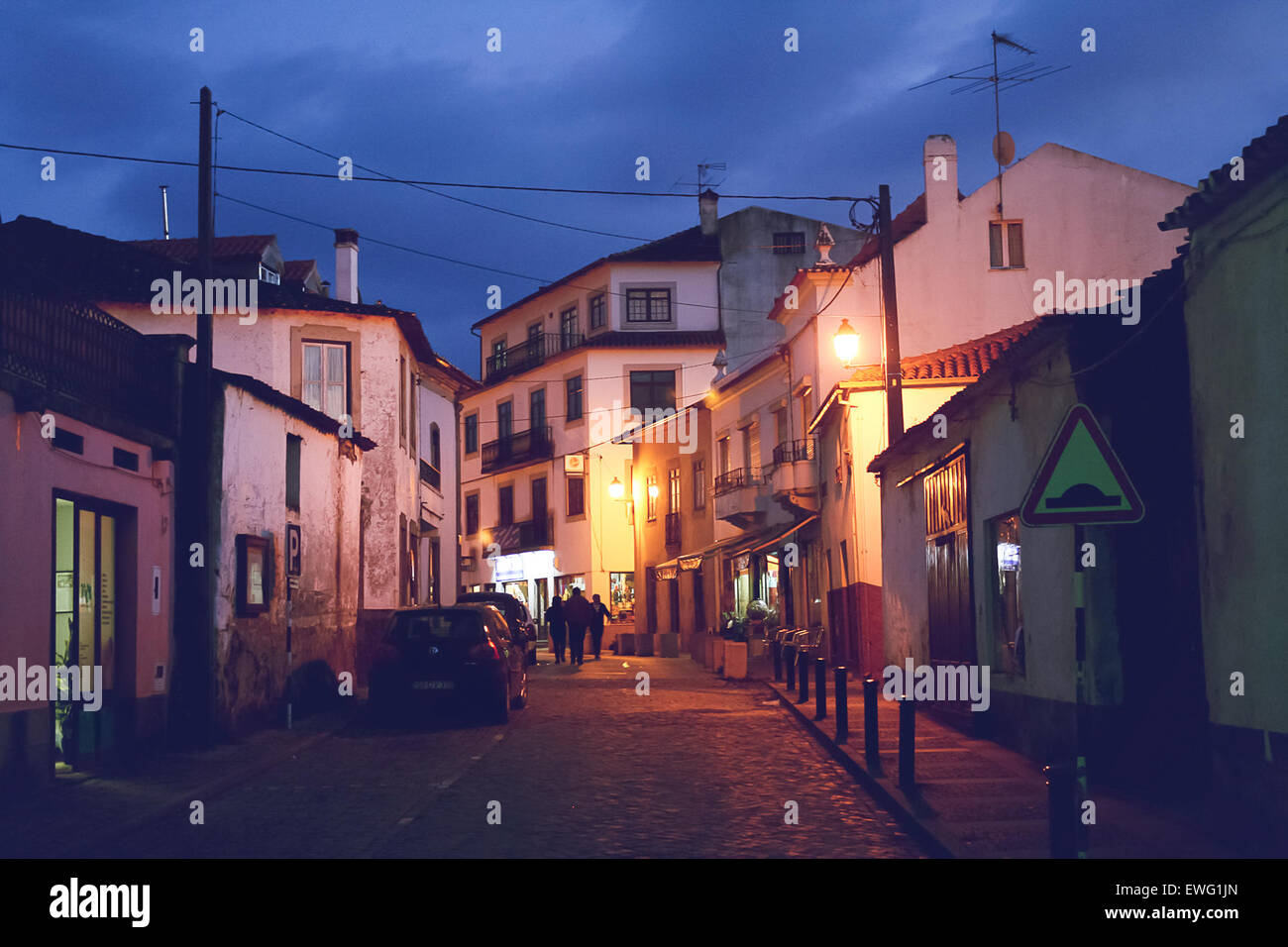 People Walking on City Street at Dusk Architecture City Street Streetlight buildings dusk group night outdoor sky - Stock Image