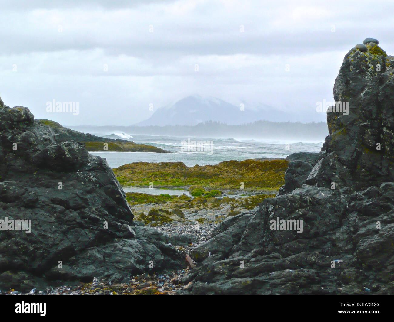 Rocky Shore of Tumultuous Sea - Stock Image