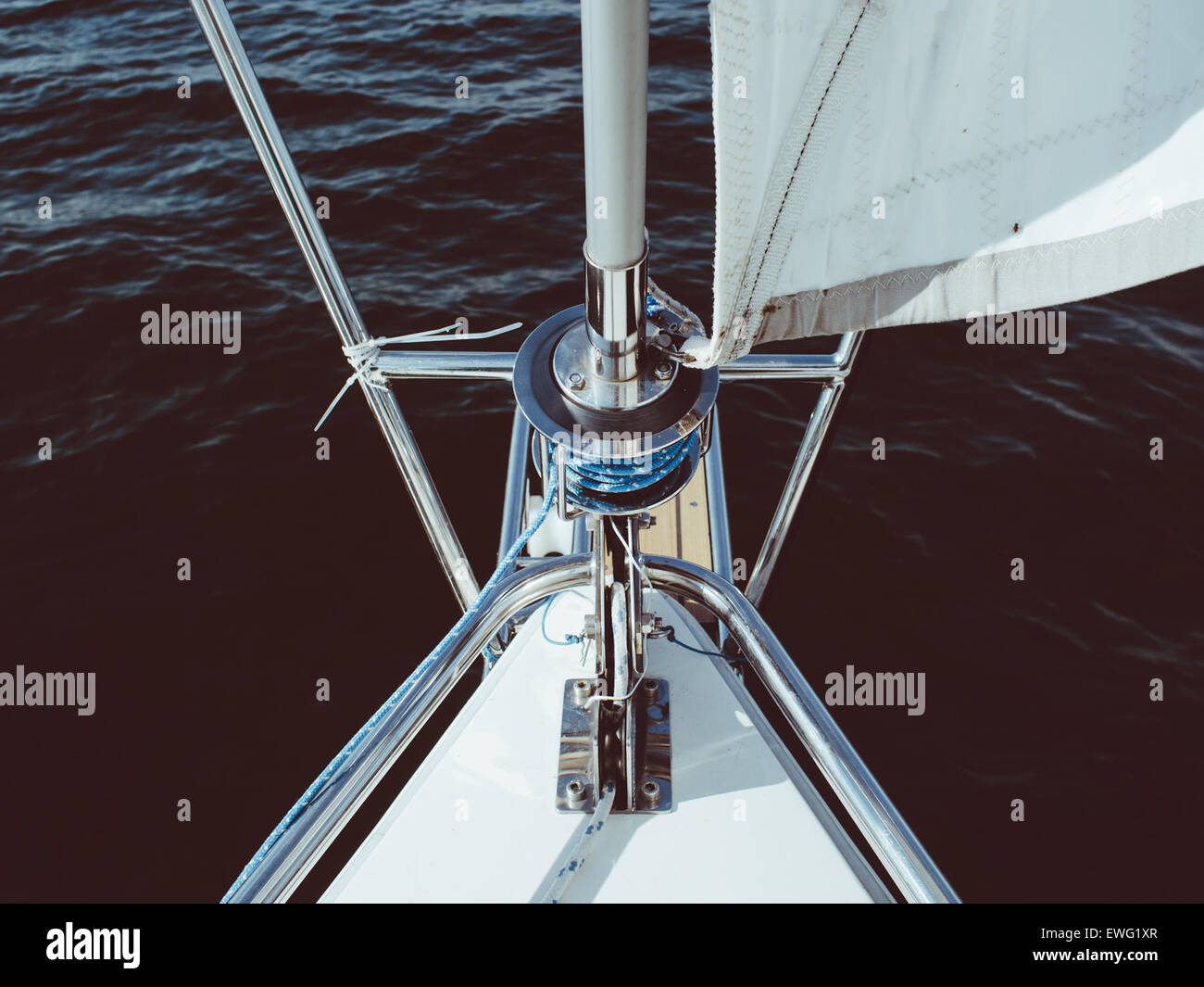 Sailboat Wench on Boat in Water Boat Nautical Sailboat Wench Sailing Wench Water Wench ocean outdoor sail boat sailing - Stock Image