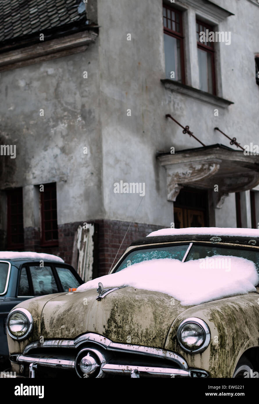 Vintage Car with Snow on Hood Antique Vintage Car automobile car snow vintage - Stock Image
