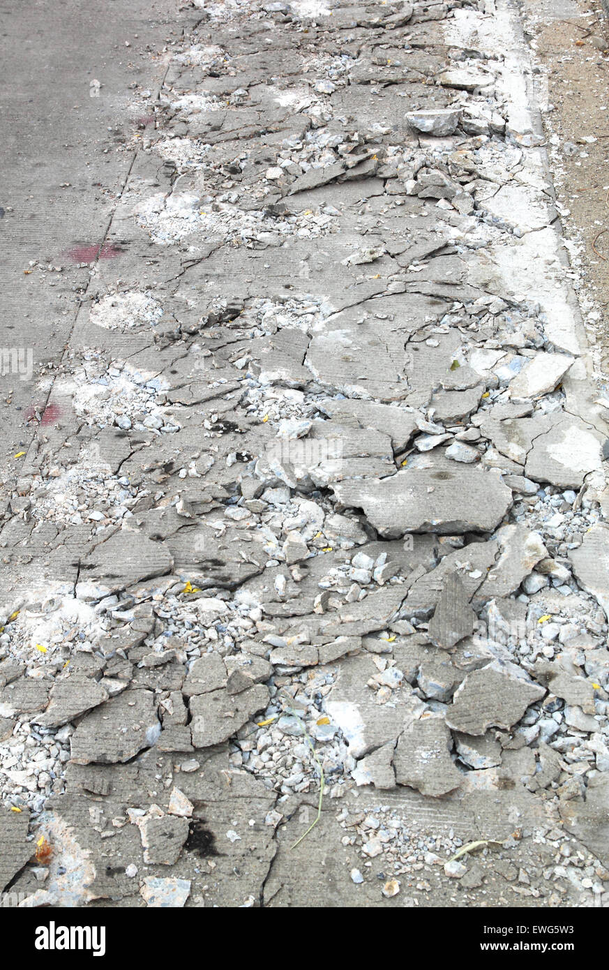 Cement fracture surface destruction construction of the road. - Stock Image