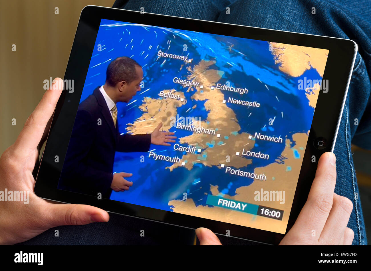 Watching the weather on the BBC News channel online streaming via an iPad Air - Stock Image
