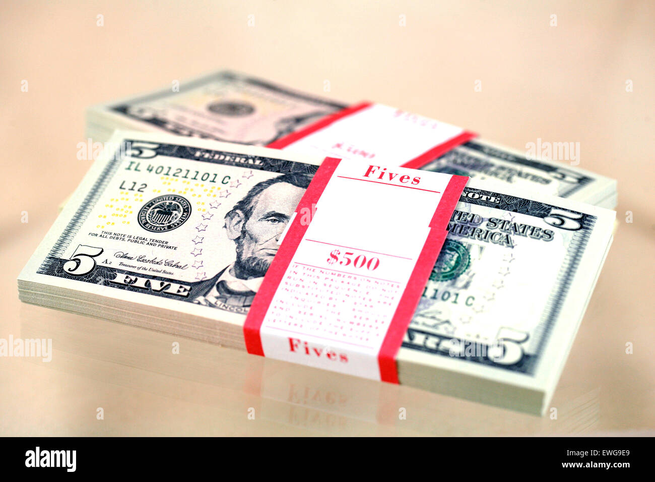 500 in fives wrapped and ready to go. - Stock Image