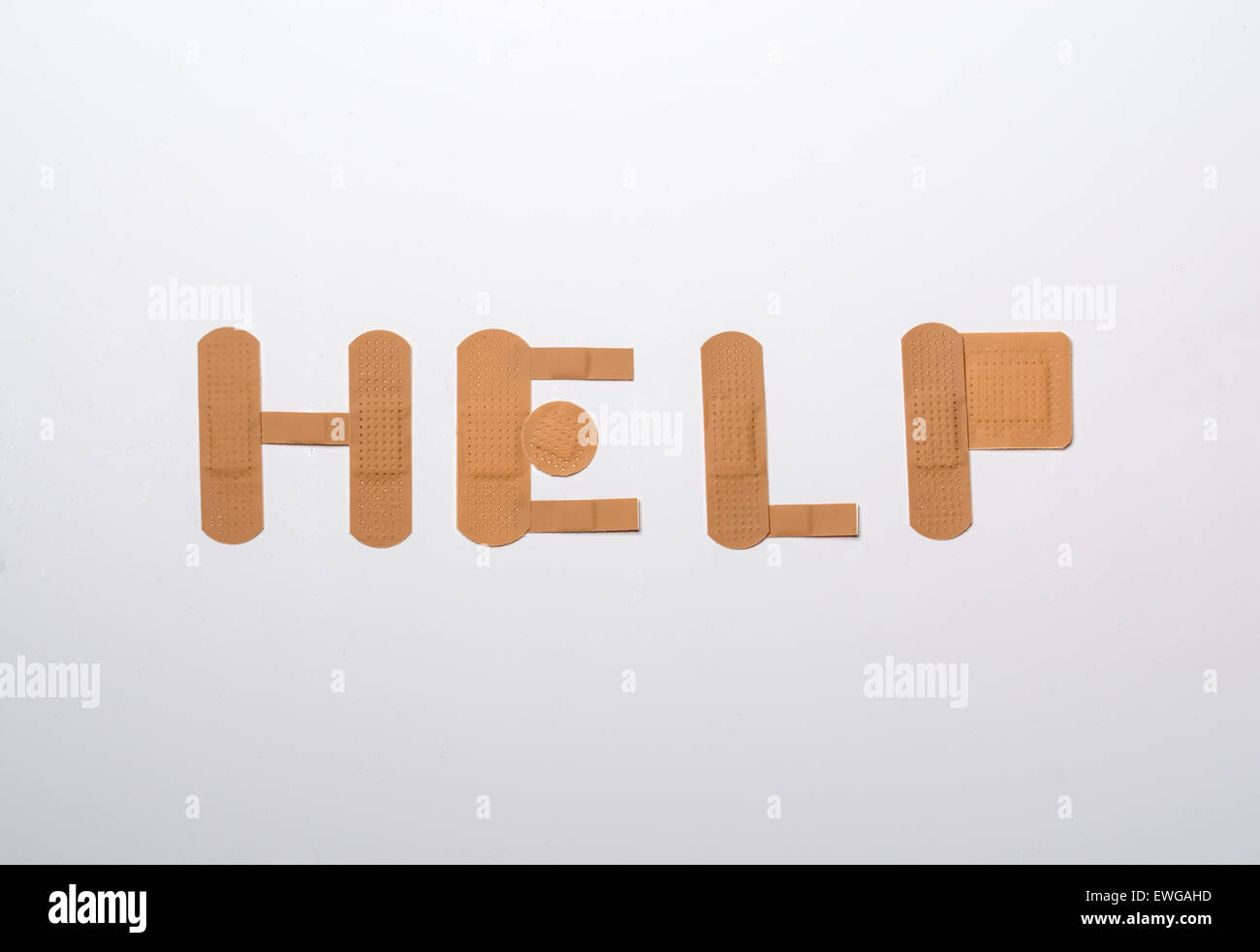 bandages forming the word help over white background Stock Photo