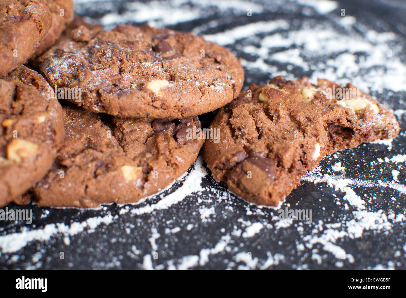 Chocolate cookies and flour - Stock Image