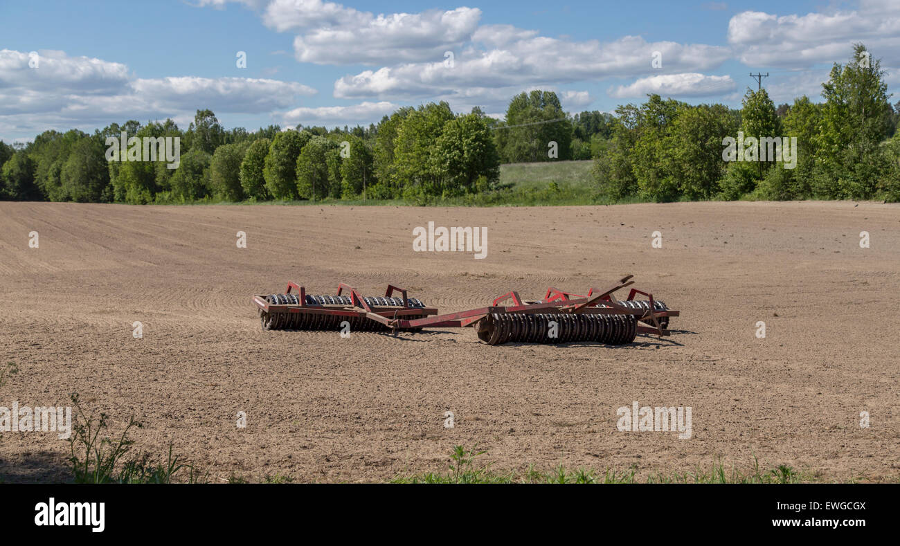 A Agricultural Roller Tool in Swedish field. - Stock Image