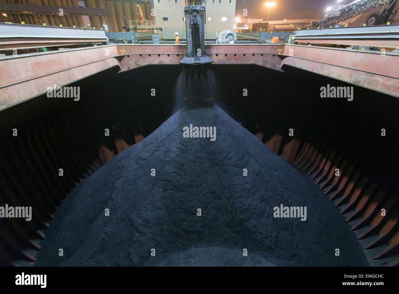ship loading coke at night - Stock Image