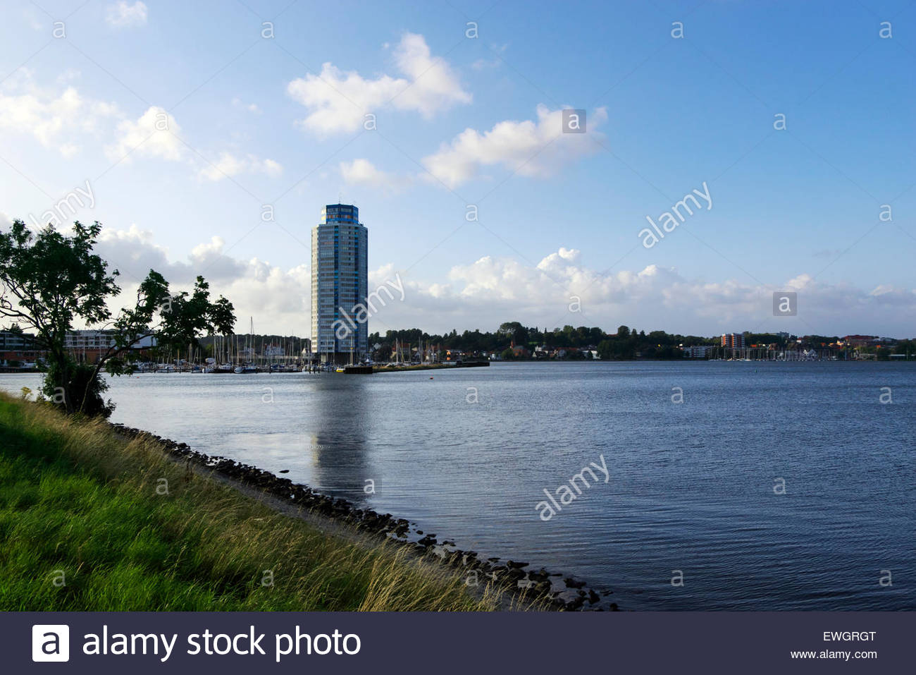 The Wikingturm (Viking Tower) dominates the skyline of Schleswig, the Wiking Yachthafen at its base. - Stock Image