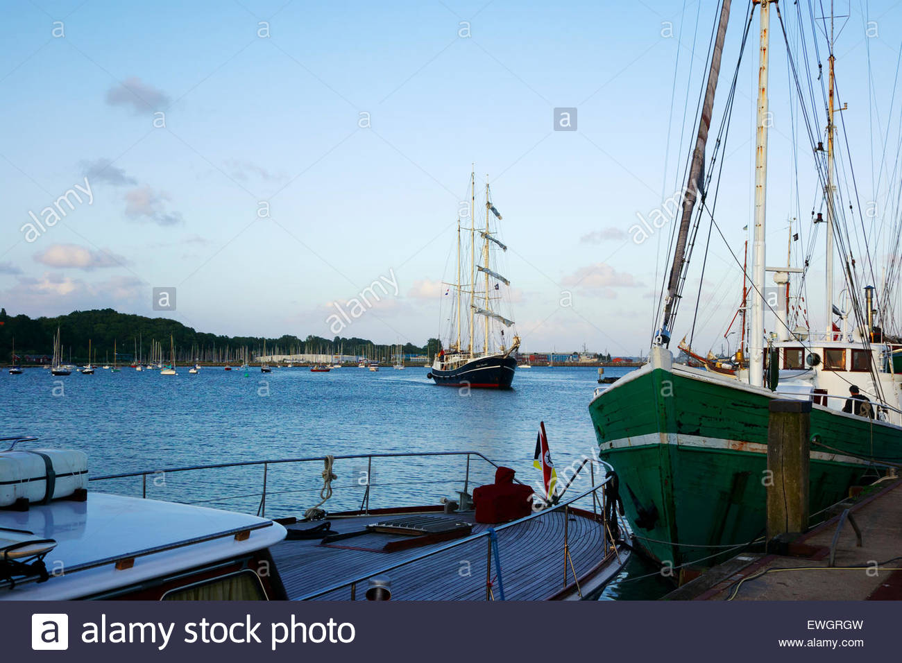 Tall ships and other yachts in the harbor of Eckernförde, a city located at the eastern end of the Danevirke - Stock Image
