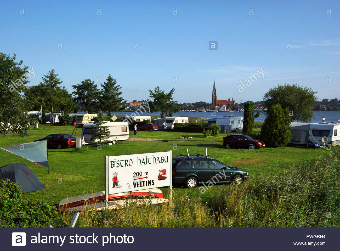 The Hedeby campground, city of Schleswig in background, is across the road from the Wikinger Museum, Haithabu. - Stock Image