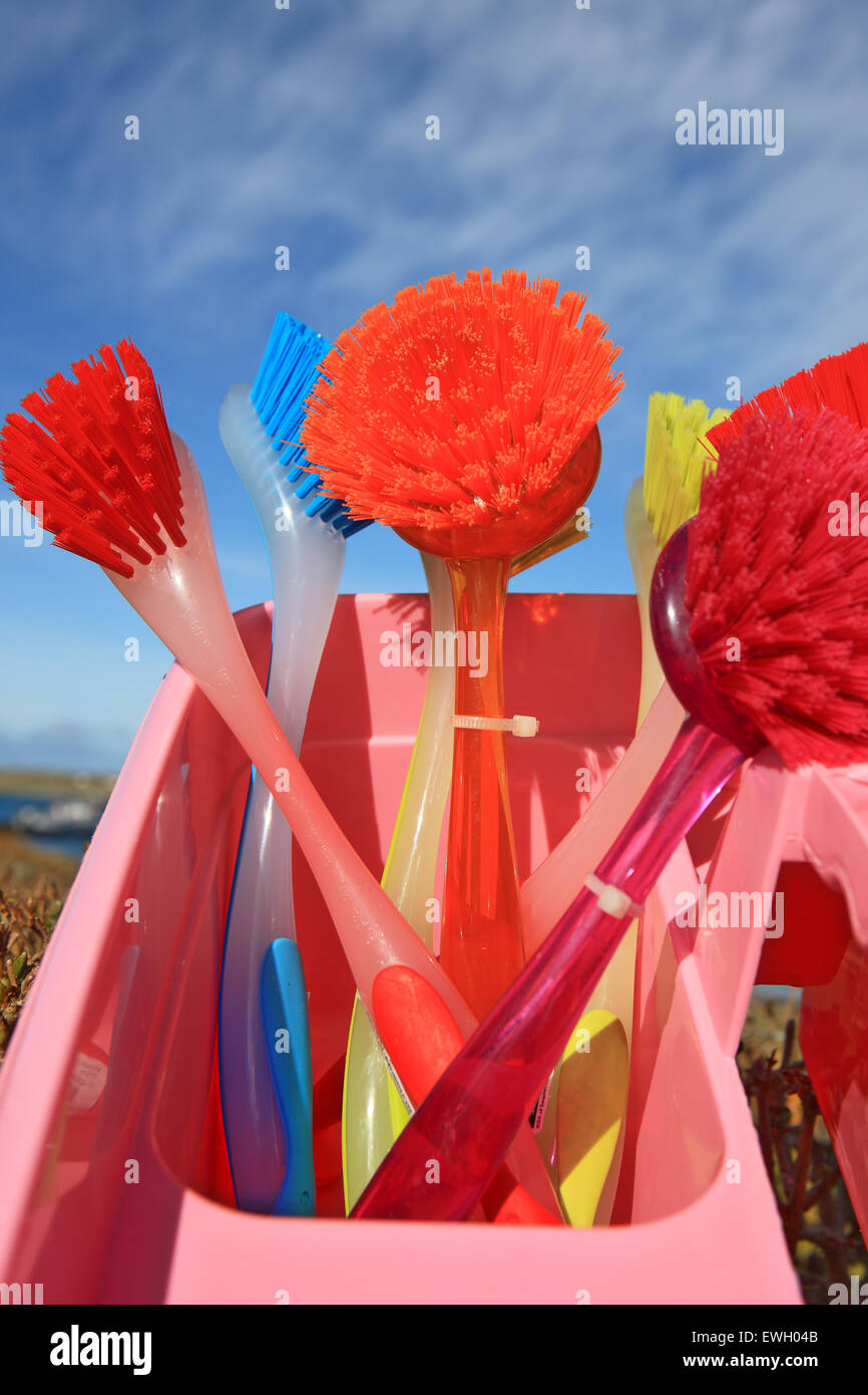 Brightly coloured dish washing brushes - Stock Image