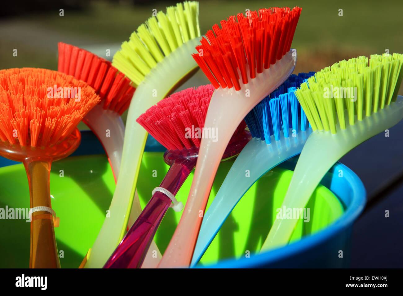 Brightly coloured dish washing brushes - Stock Image