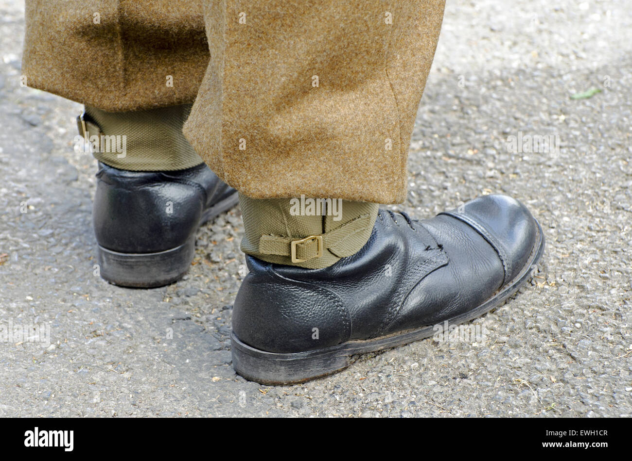 Person in WW2 British Army uniform showing standard issue army boots and gaiters - Stock Image