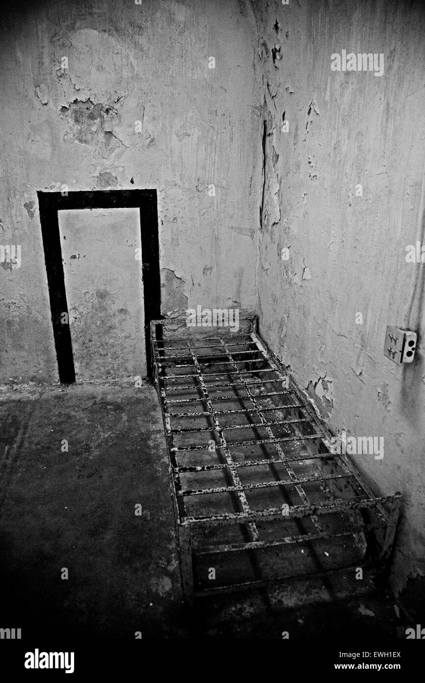 Abandoned bed frame in a cell at Eastern State Penitentiary, Philadelphia, Pennsylvania - Stock Image