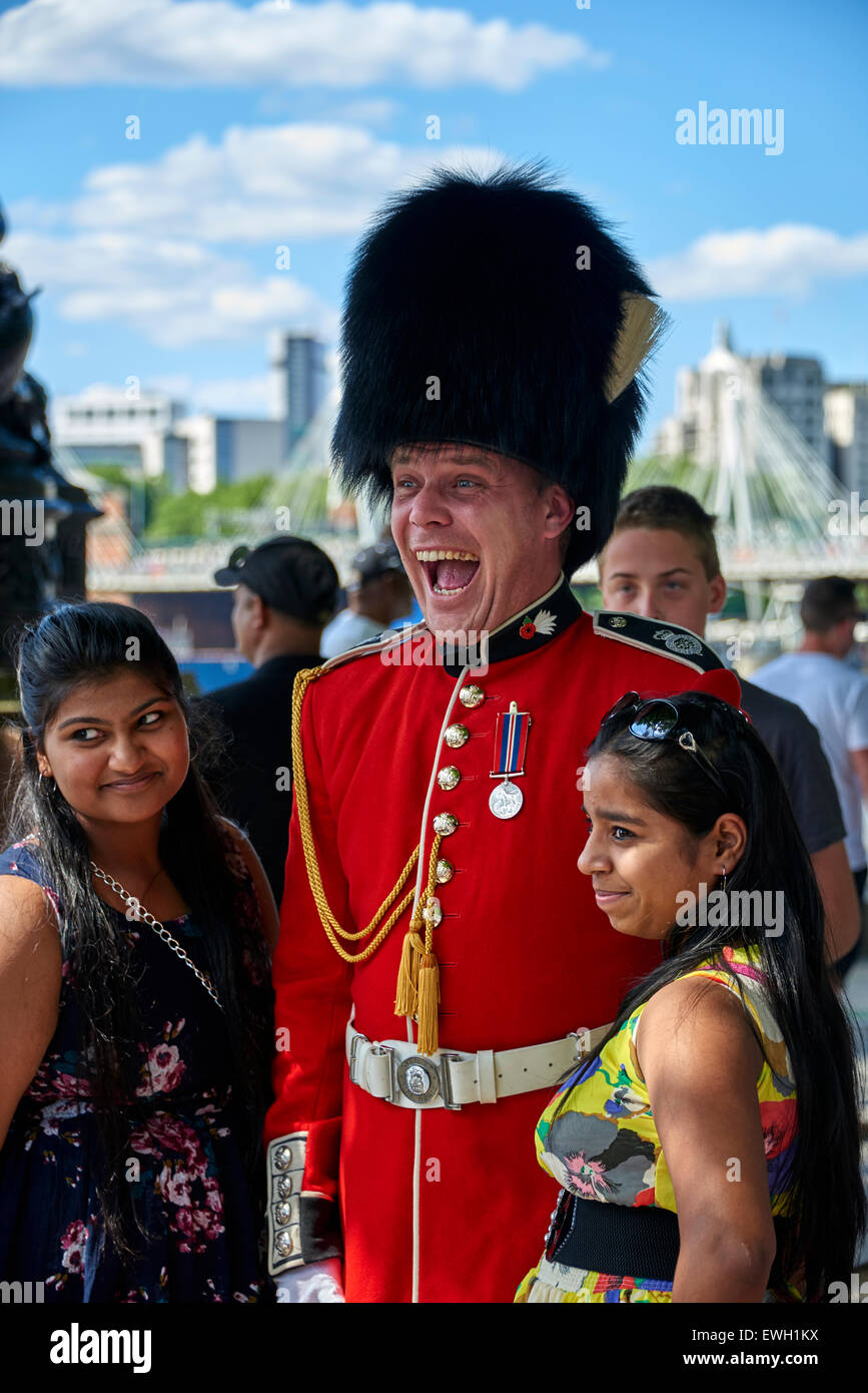 Street performers in Jubilee Gardens Public Park on the South Bank in the London Borough of Lambeth. - Stock Image