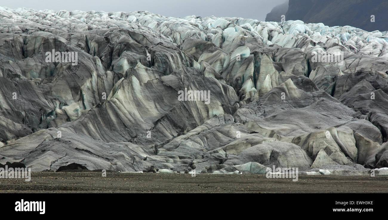 Dirty looking melting glacial ice of Vatnajökull - Stock Image