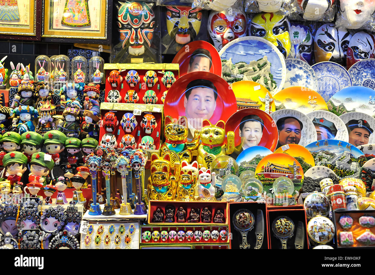 Xi Jinping face plates and other souvenirs on display at a Beijing night market - Stock Image