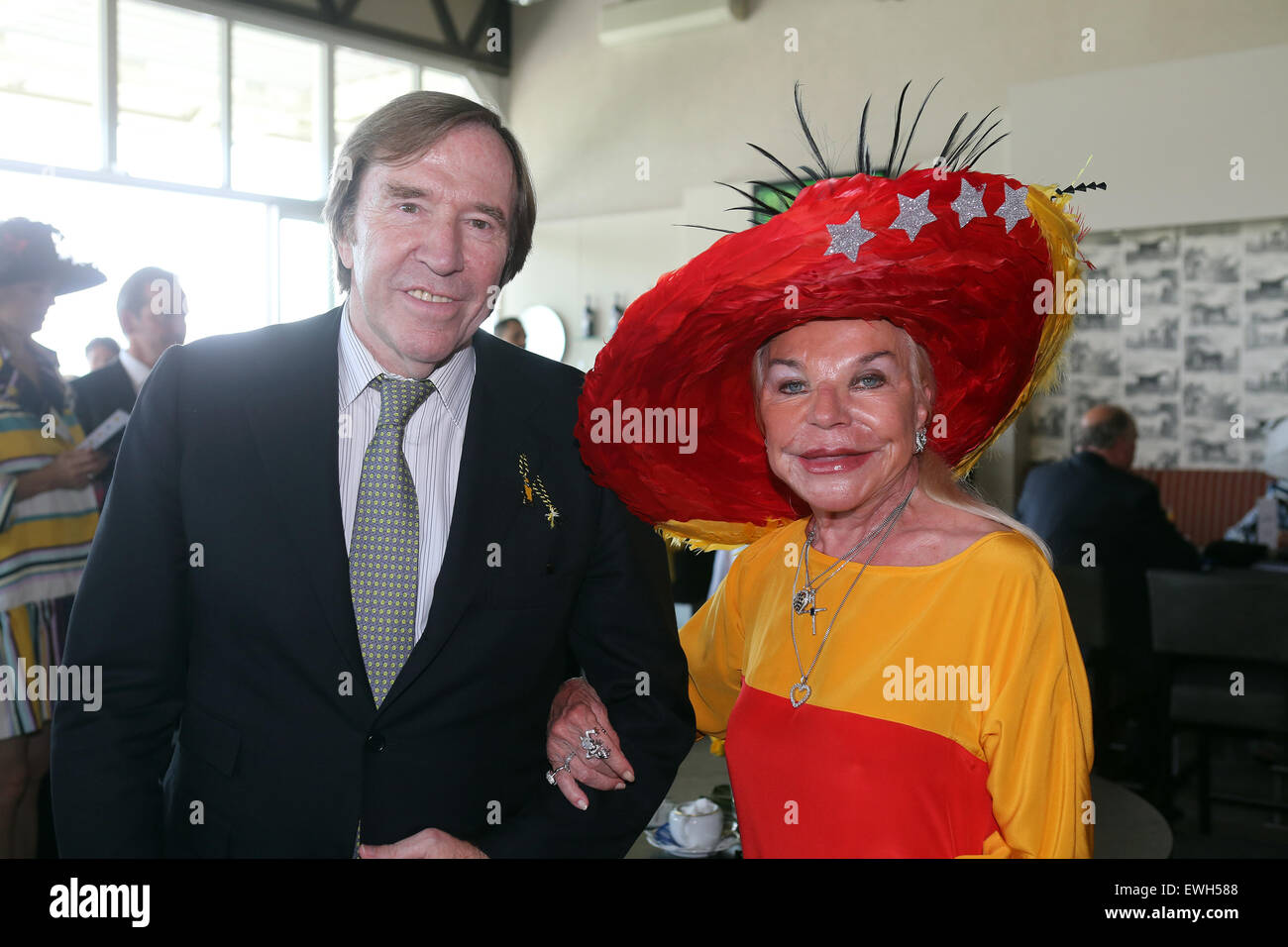Iffezheim, Germany, Guenter Netzer, media entrepreneur and television commentator and Lilly Claire Saran - Stock Image