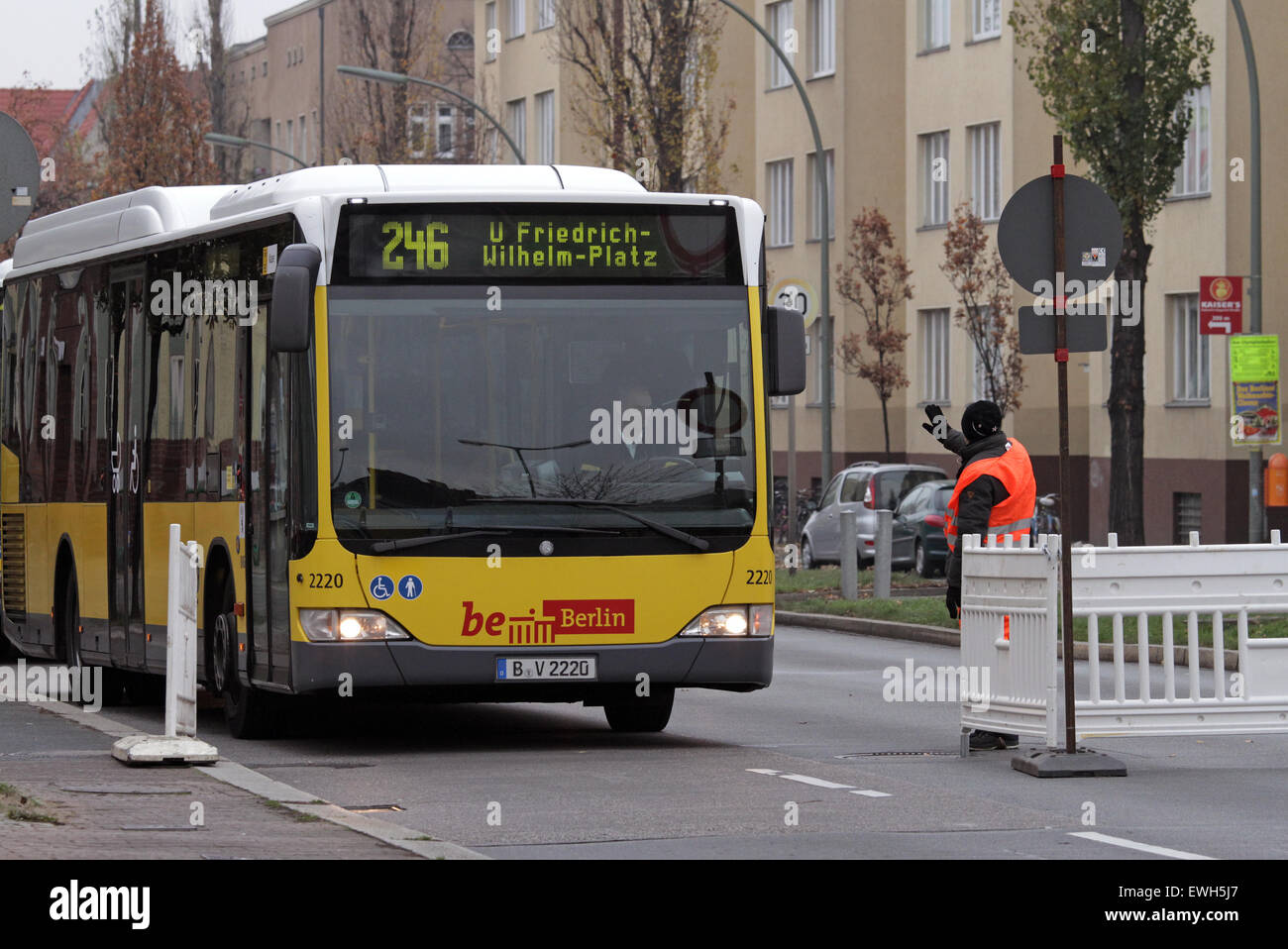 Berlin, Germany, construction workers stop a bus BVG at a roadblock - Stock Image