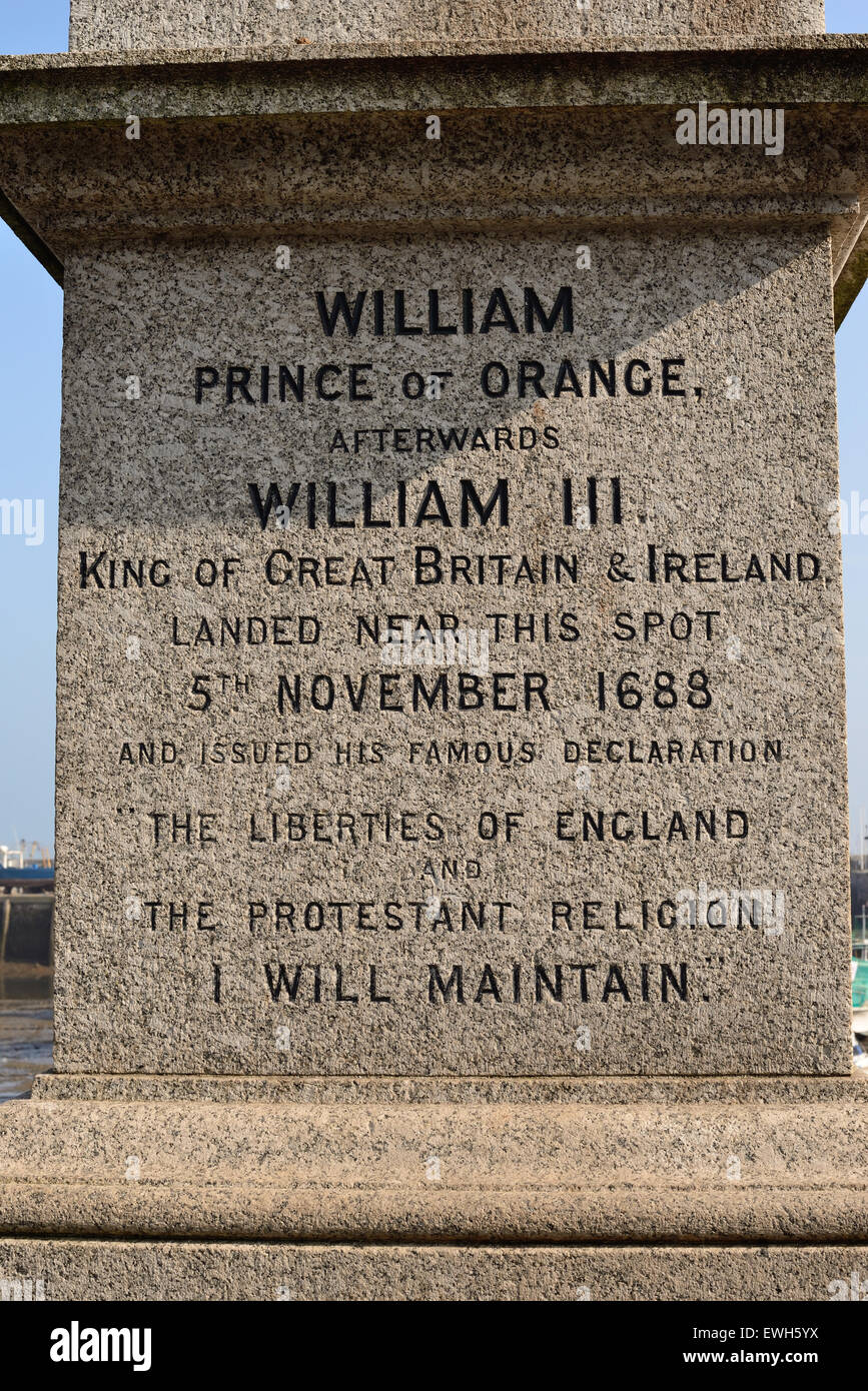 The inscription on the statue of William of Orange beside Brixham harbour. - Stock Image