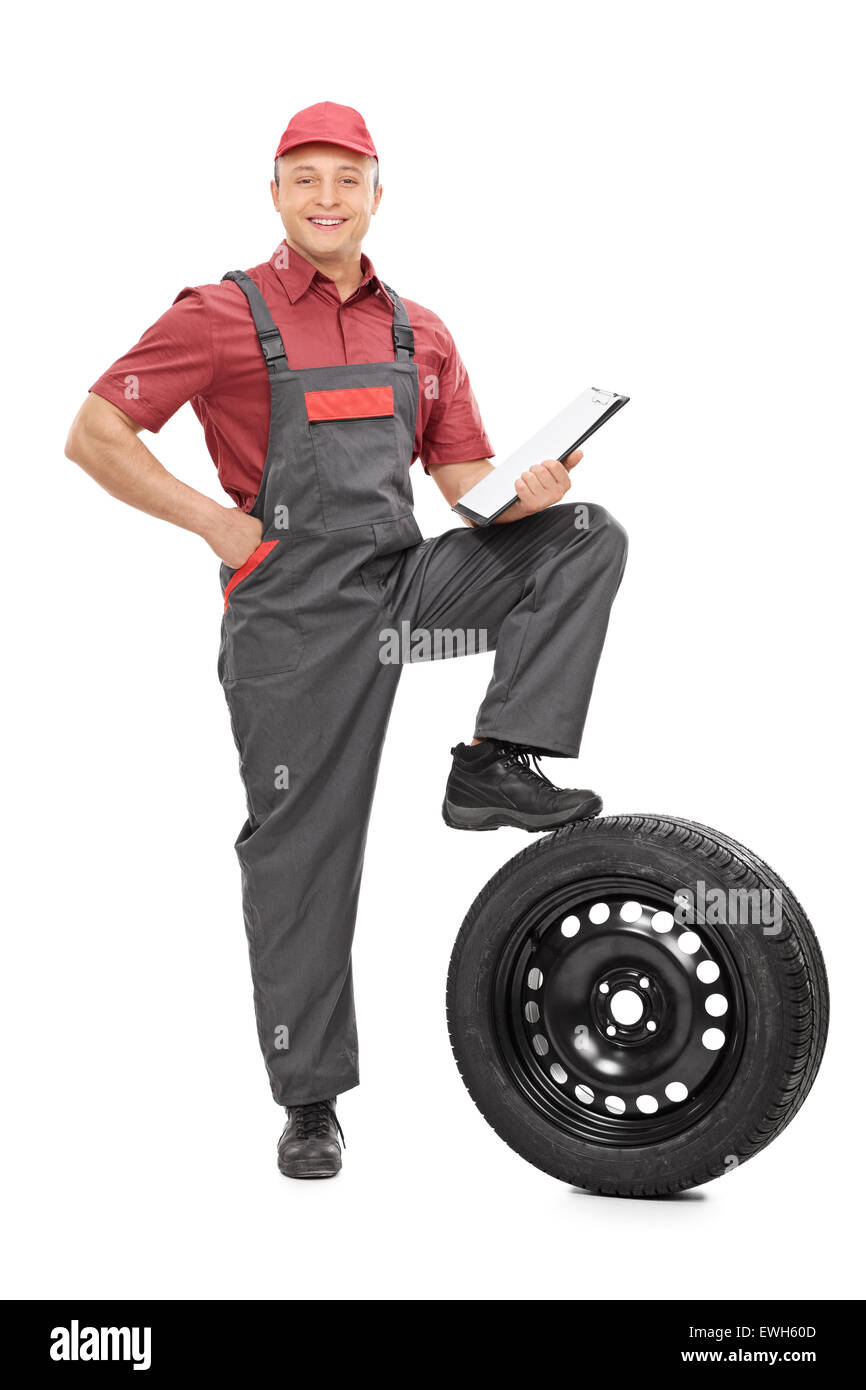 Full length portrait of a young mechanic holding a clipboard and looking at the camera isolated on white background Stock Photo