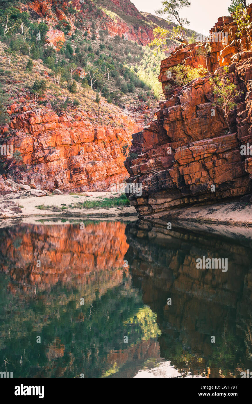 Reflection in water of red rocks at Ormiston Gorge in the West MacDonnell Ranges - Stock Image