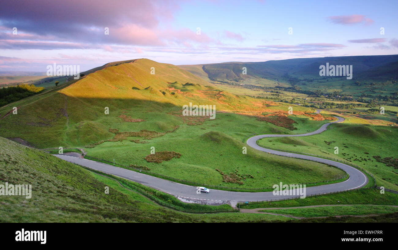 The winding road to Edale looking to Rushup Edge seen from Mam Tor and Rushup Edge, Hope Valley, Peak District, - Stock Image