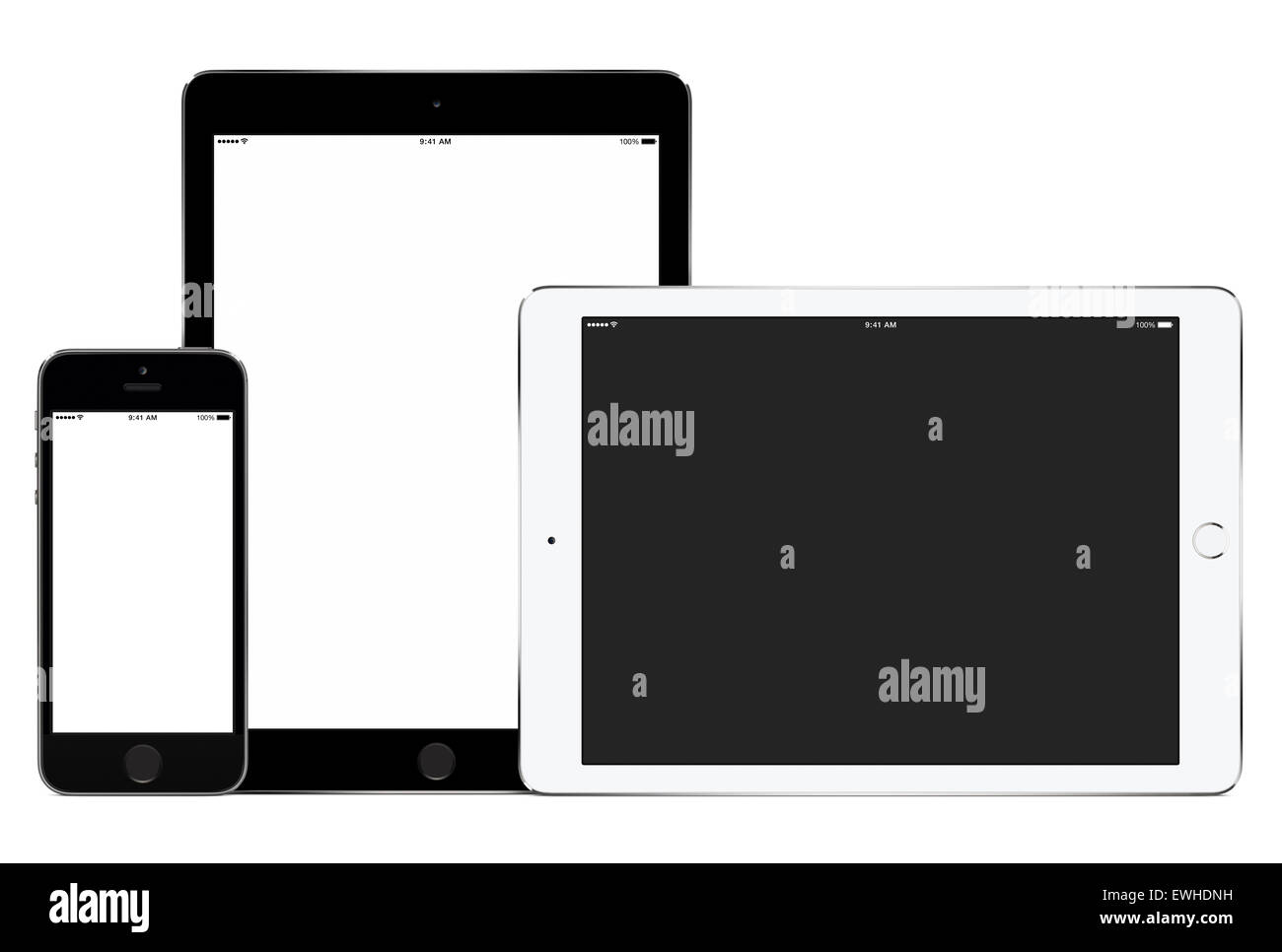 Mockup of smartphone and two tablet computers in portrait and landscape orientation for responsive design presentation. - Stock Image