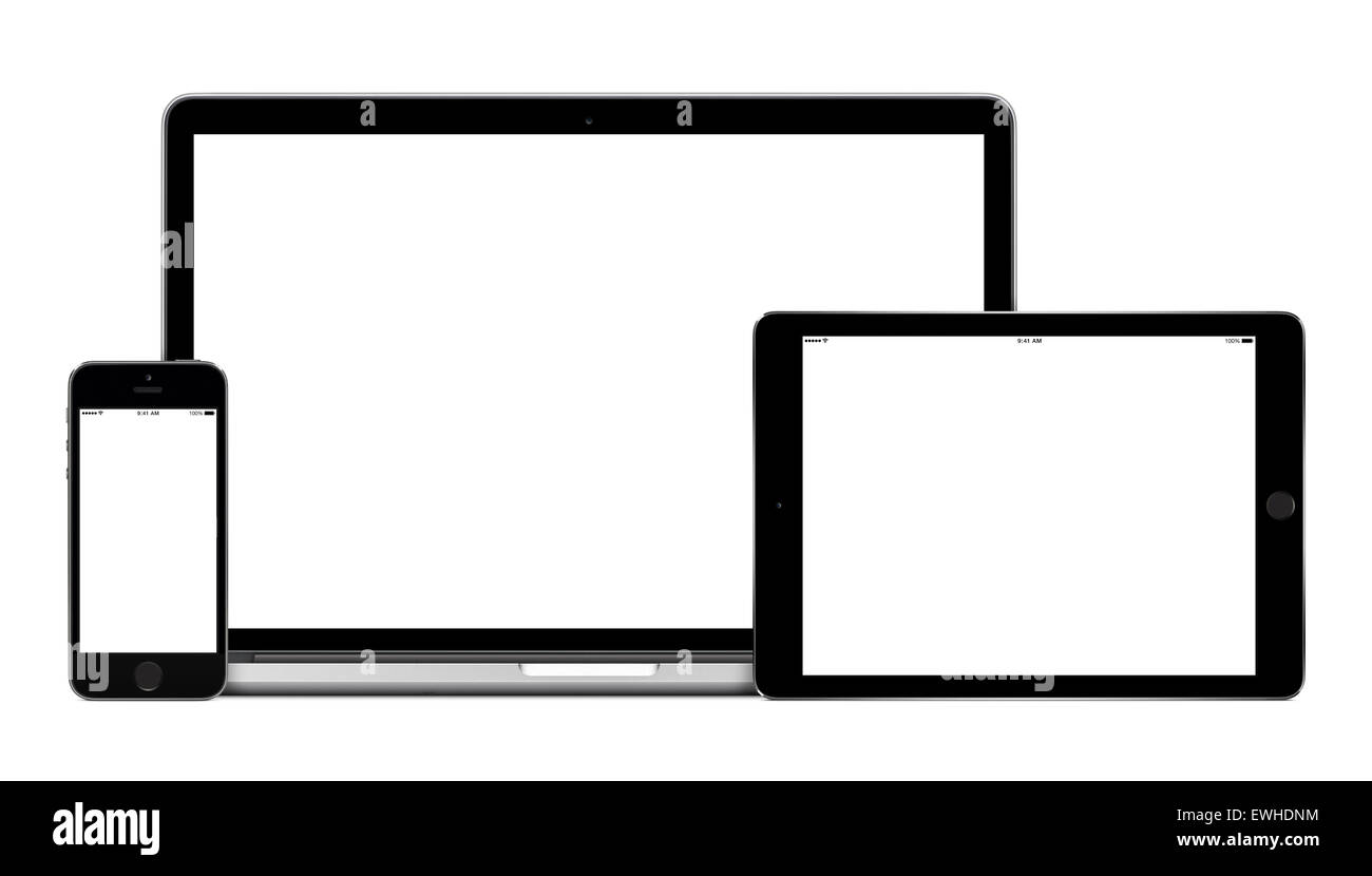Mockup consisting of laptop, tablet pc in landscape orientation and mobile smartphone with blank screen. - Stock Image