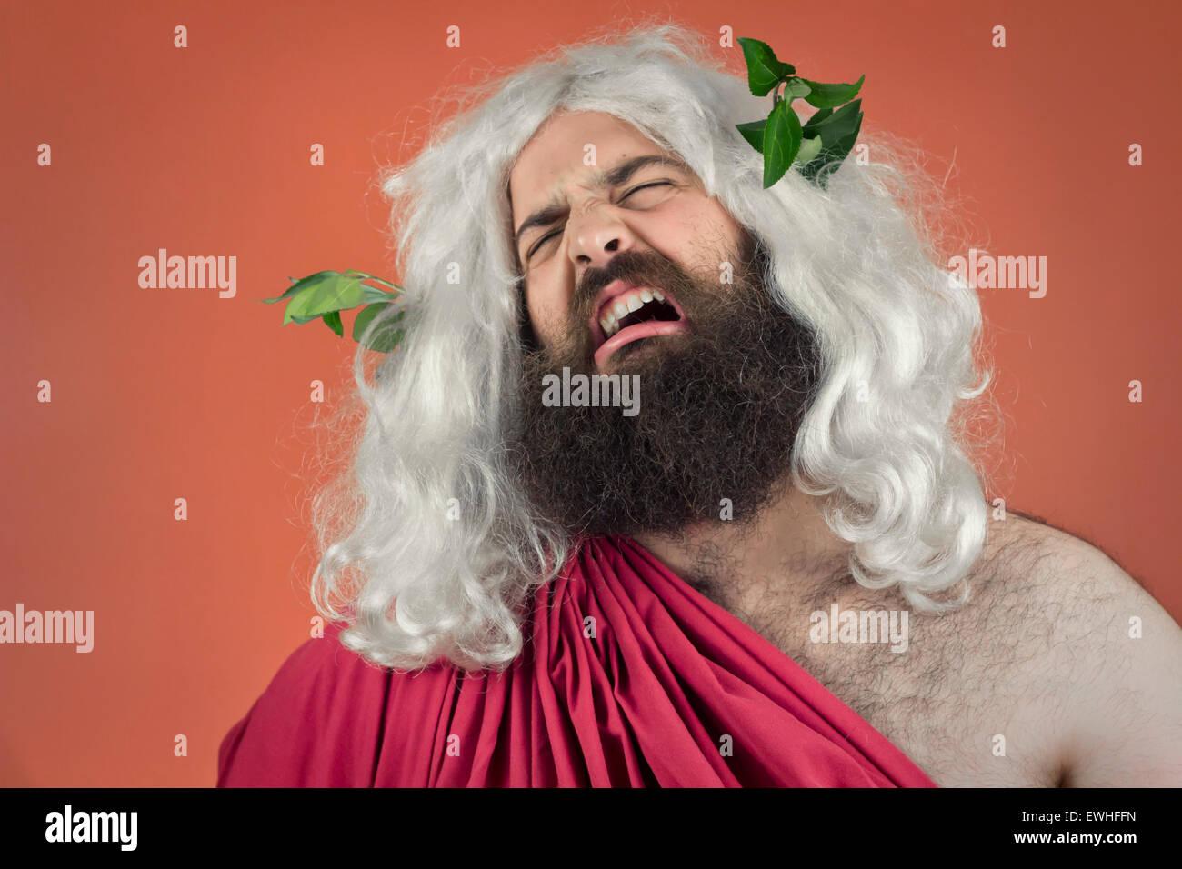Crying zeus god or jupiter against orange background Stock Photo